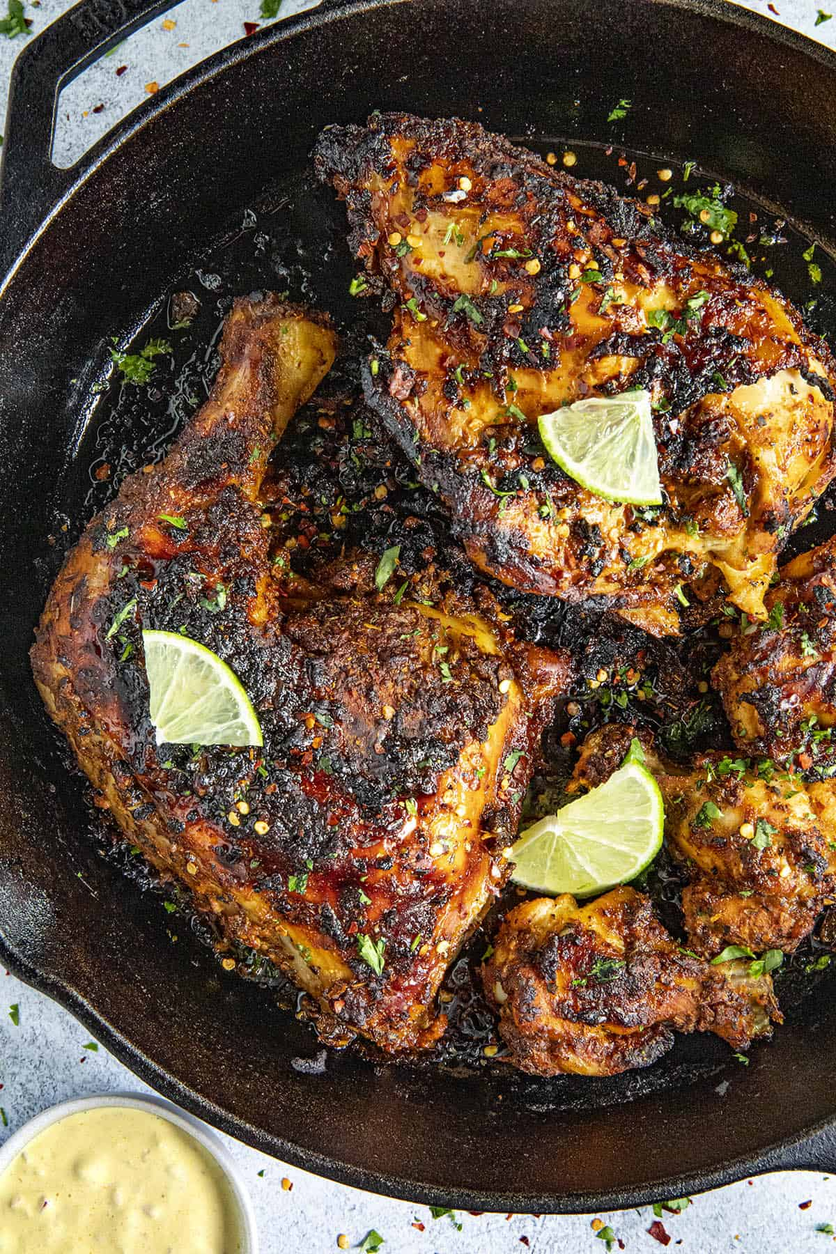Delicious Peruvian Chicken garnished with fresh slices of lime