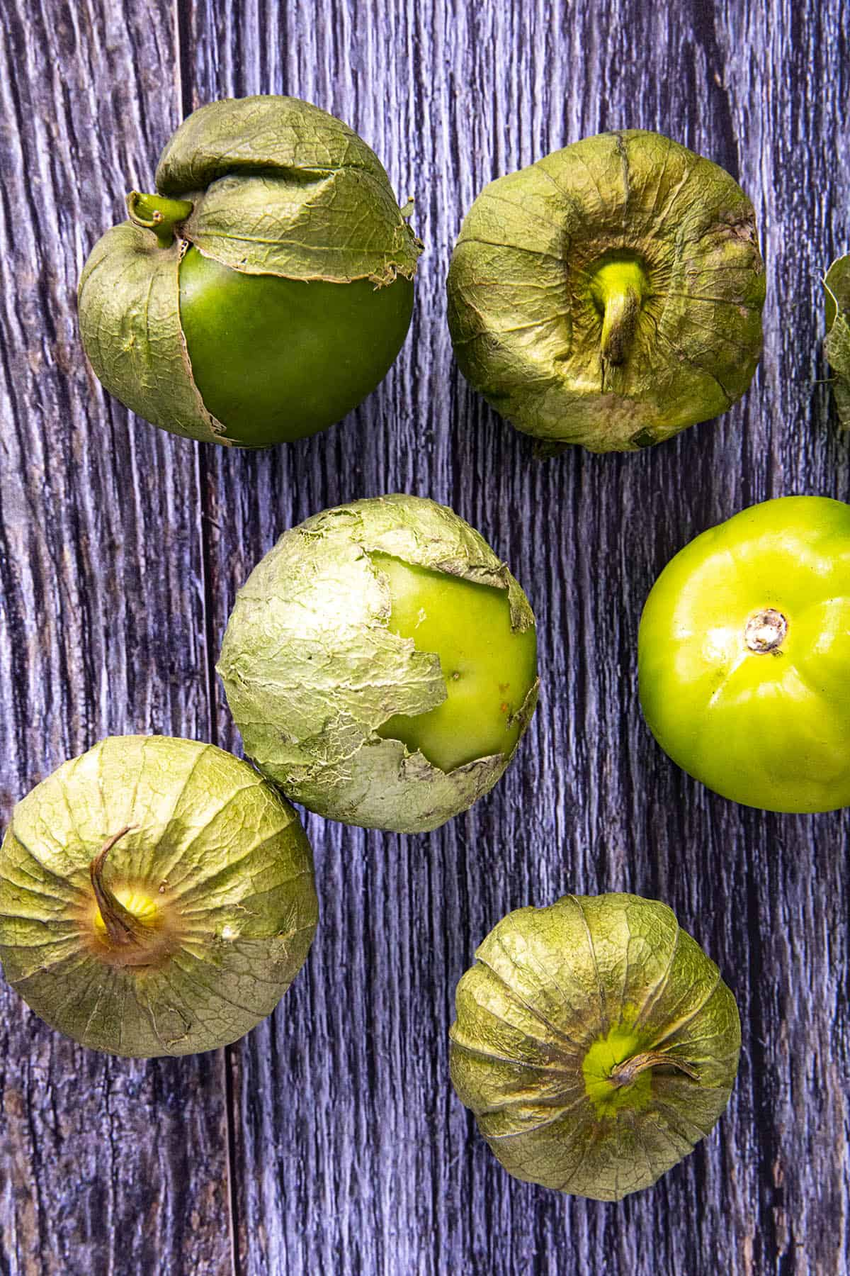 A bunch of tomatillos, ready for cooking