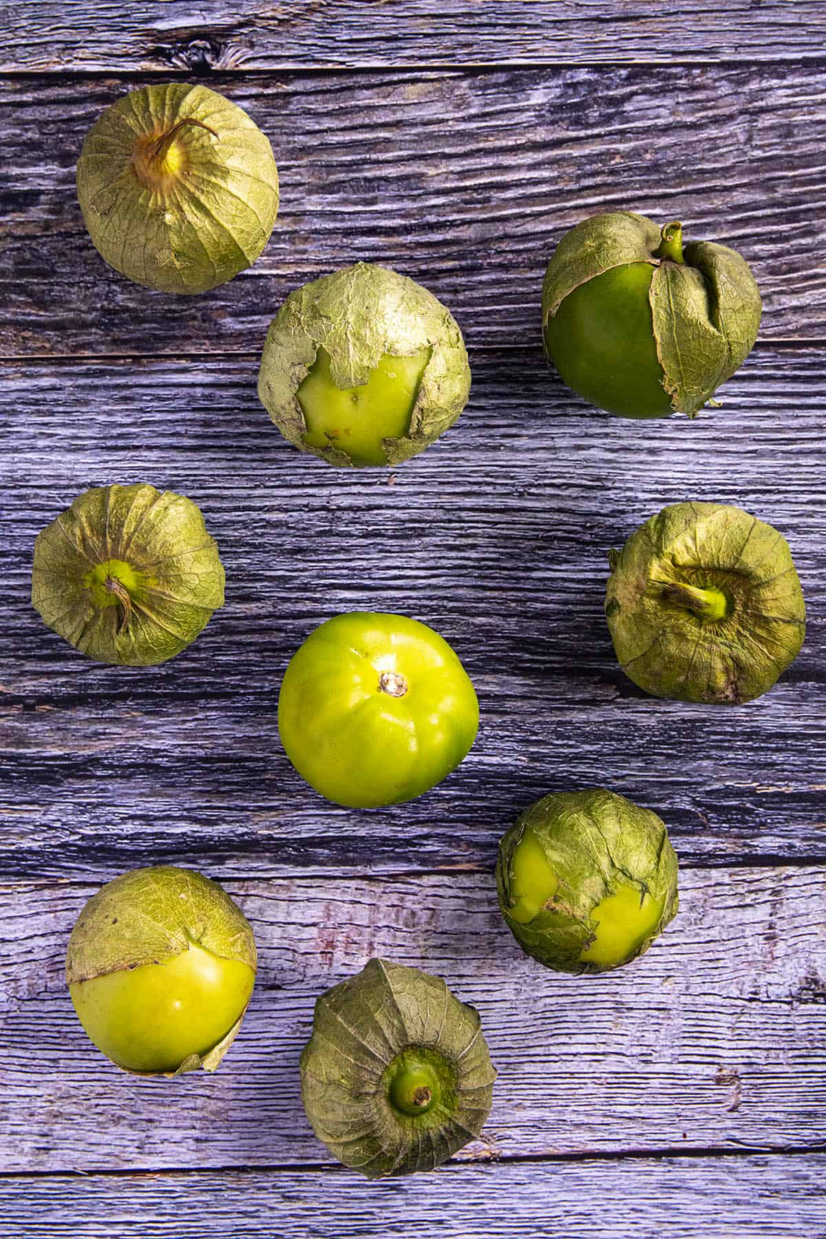 A bunch of tomatillos, ready for peeling