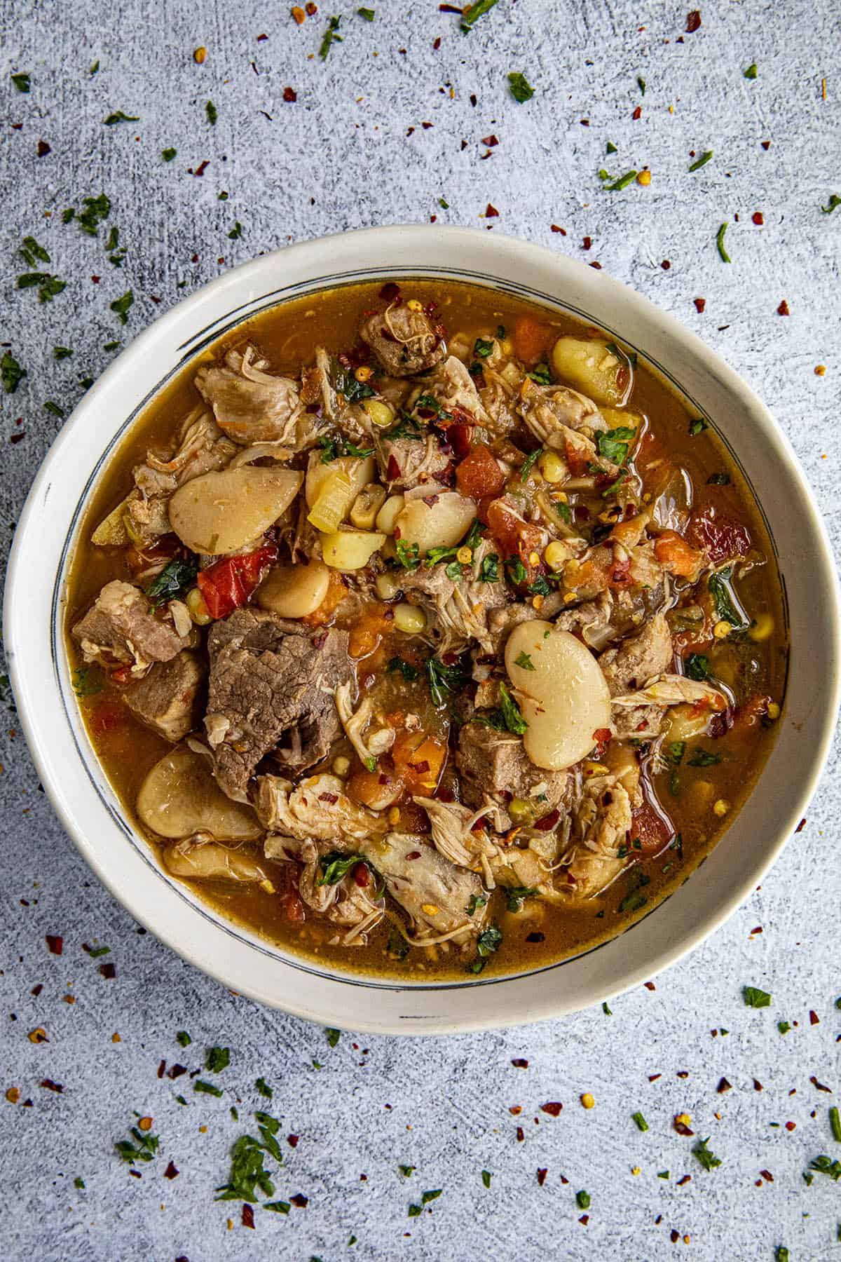 Chunky burgoo stew in a bowl with loads of meat and vegetables