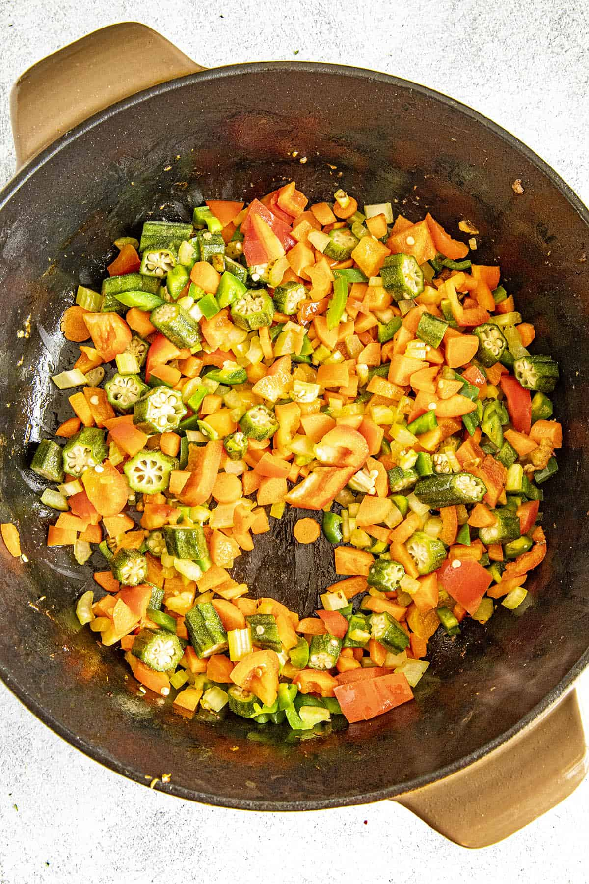 Cooking down the vegetables to make burgoo