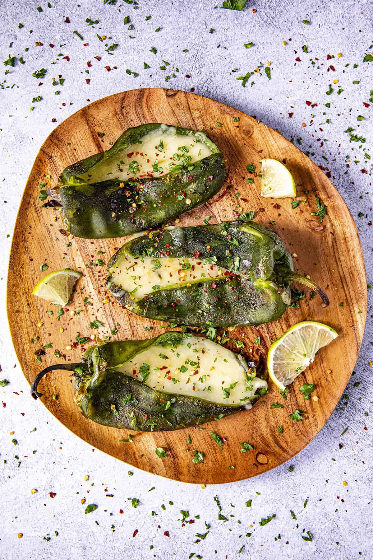 Three Grilled, Cheese Stuffed Poblano peppers on a plate