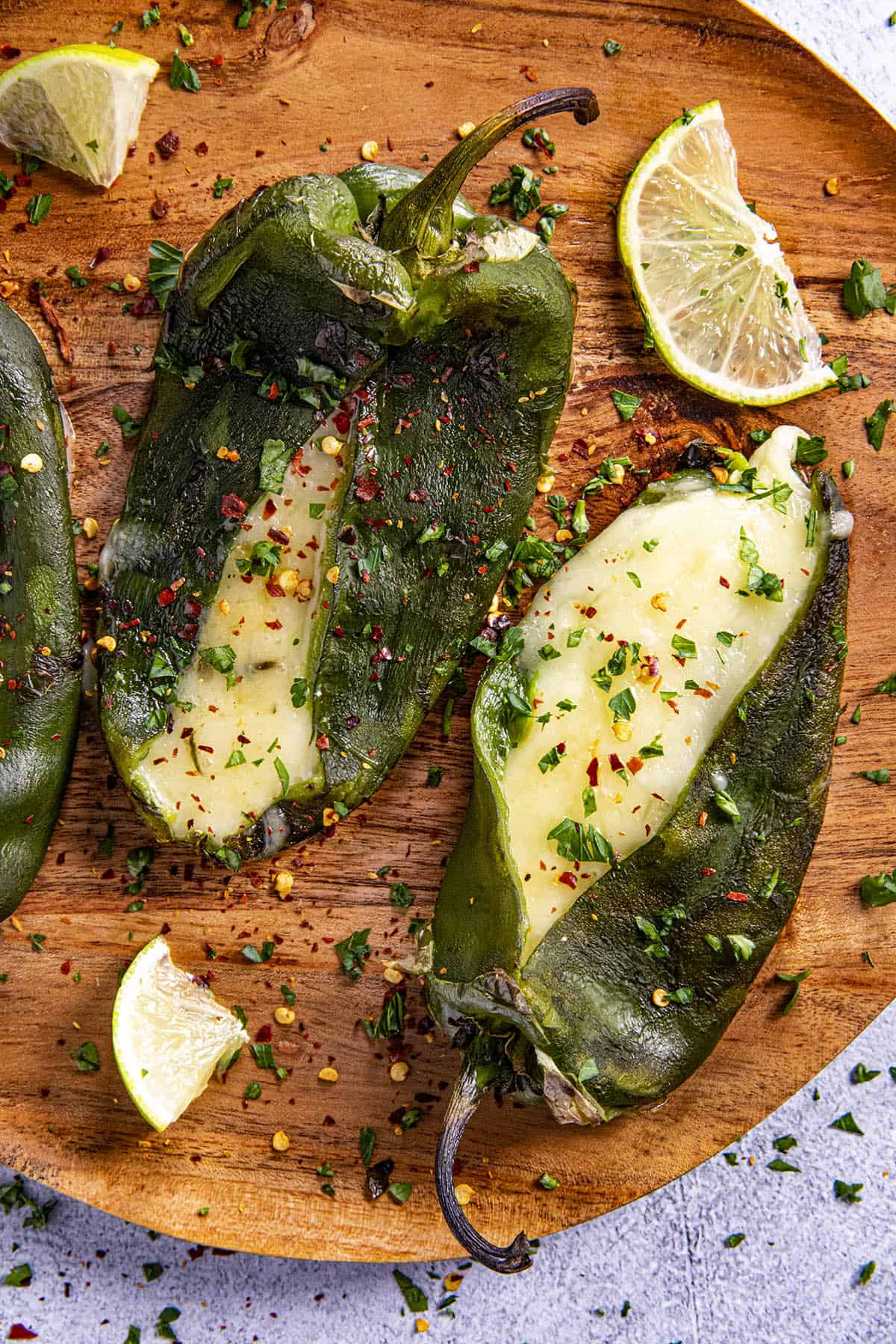 Poblano peppers stuffed with cheese on a plate