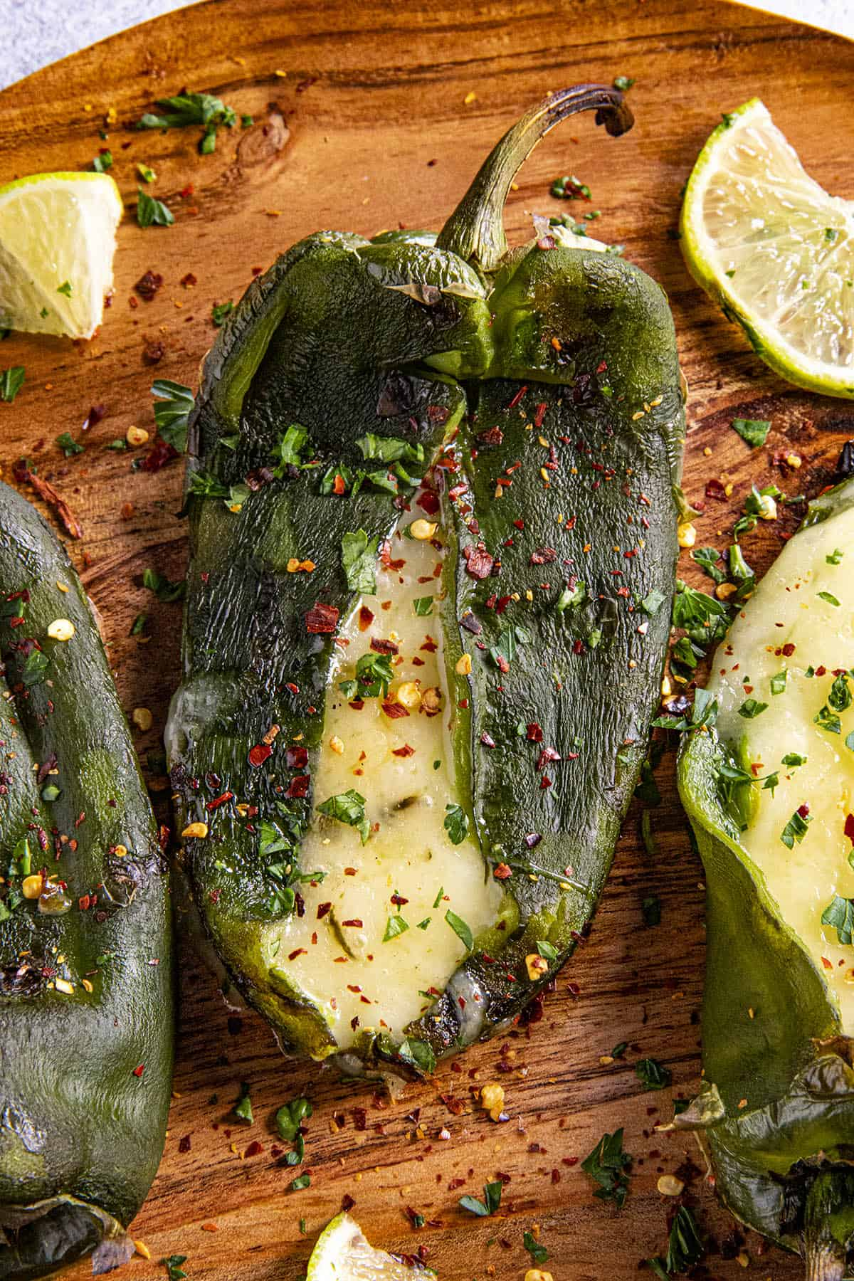 A poblano pepper that has been stuffed with cheese and grilled