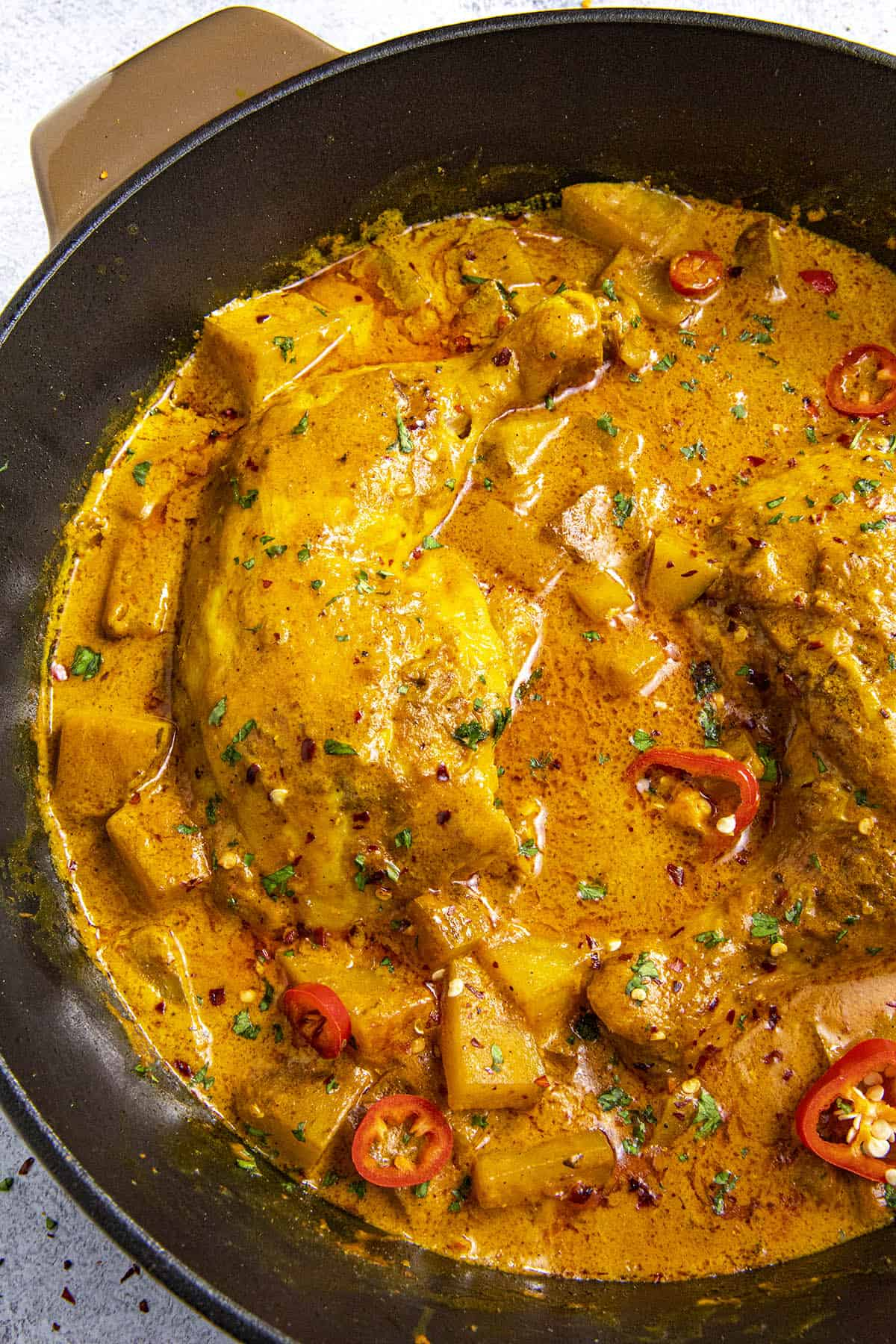 Jamaican Curry Chicken simmering in a pan