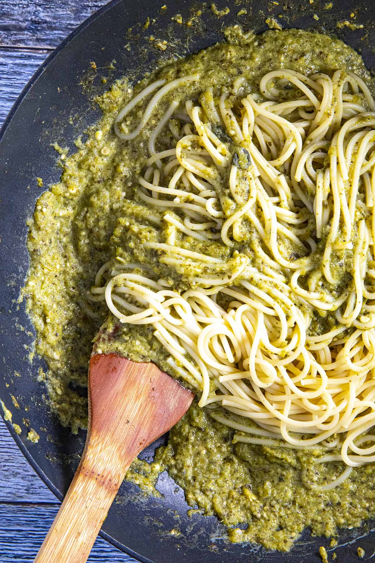 Swirling cooked spaghetti noodles into the Spaghetti Verde sauce