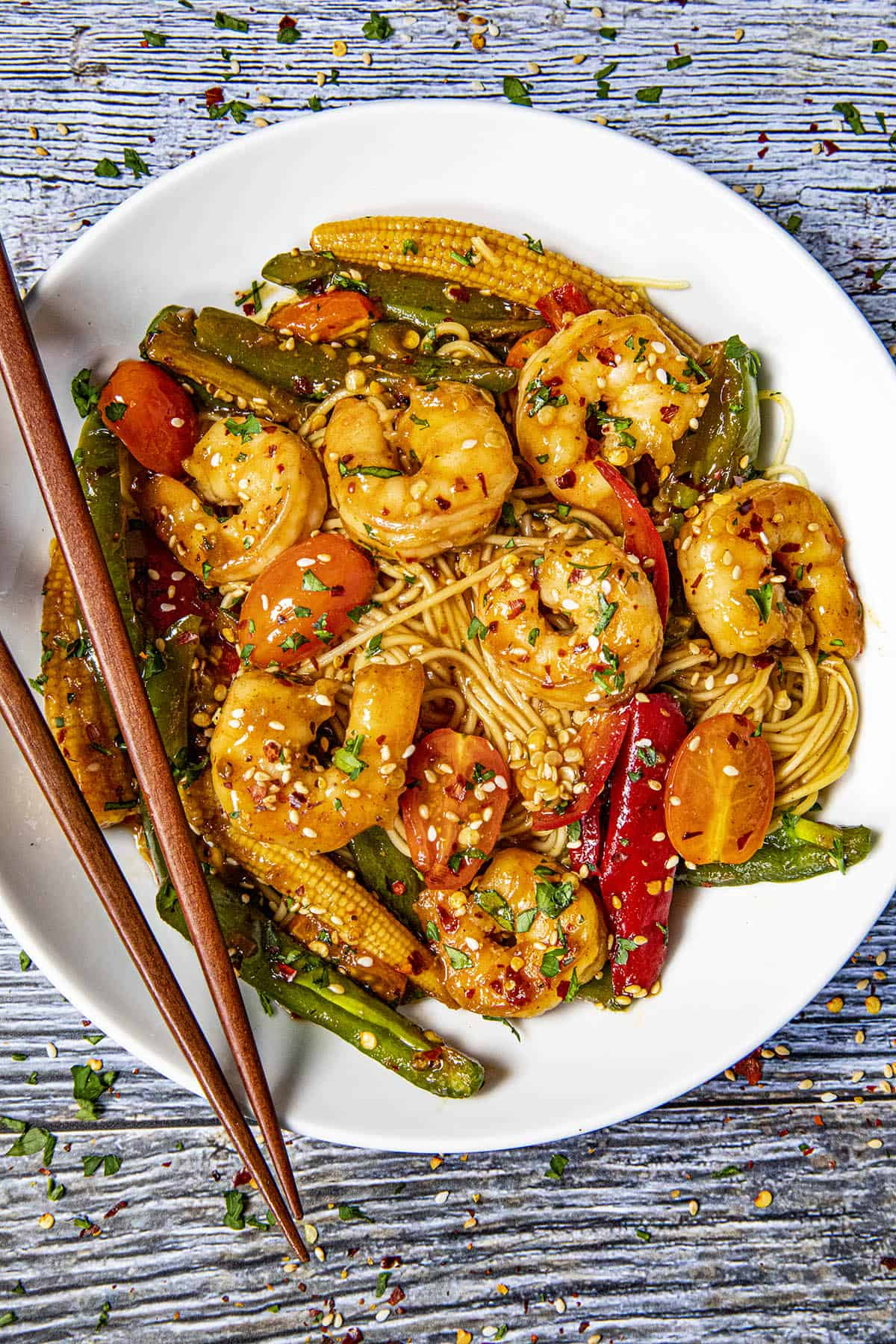 Teriyaki Shrimp Stir Fry in a bowl with chopsticks