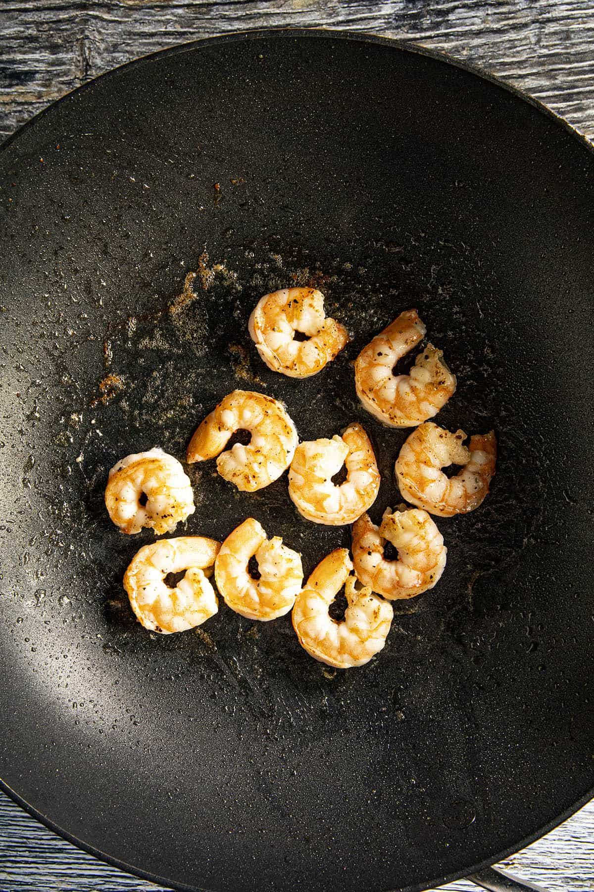 Cooking the shrimp in a pan to make Teriyaki Shrimp Stir Fry