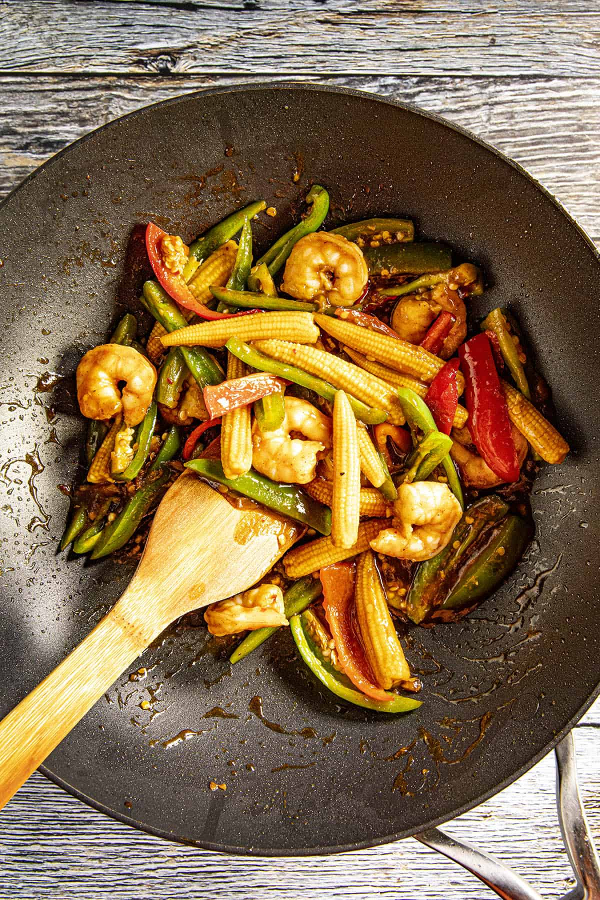 Stirring together the Teriyaki Shrimp Stir Fry ingredients in a pan