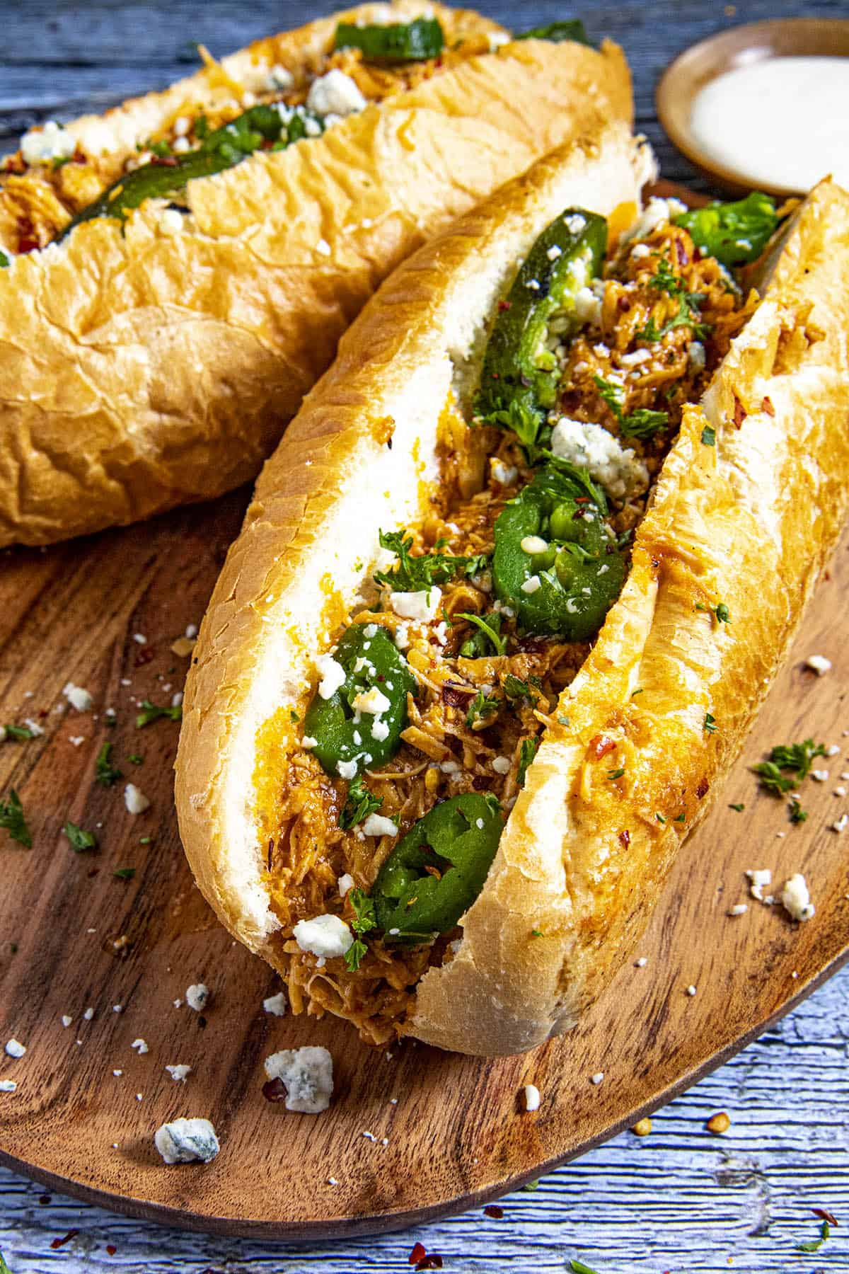 Buffalo Chicken Sandwiches with blue cheese crumbles and roasted jalapenos