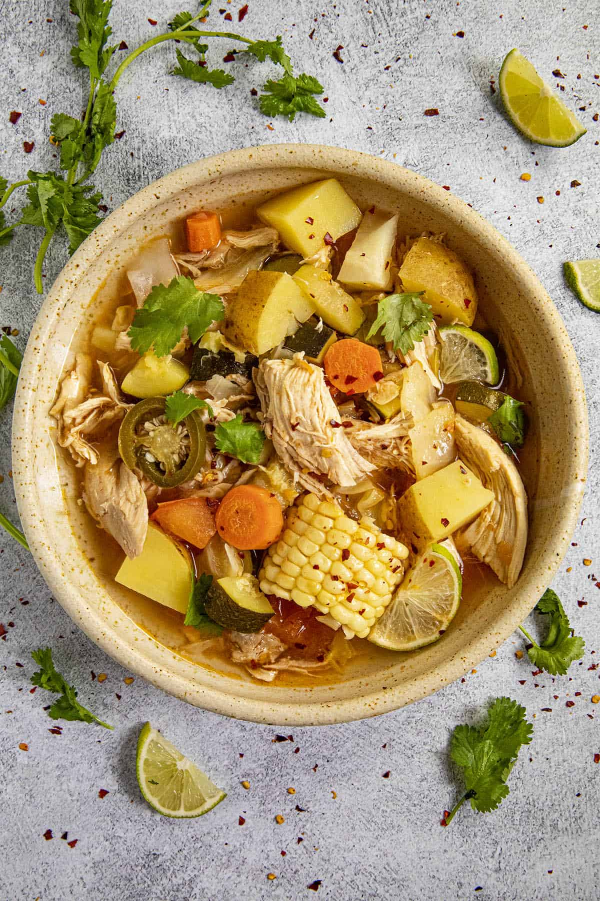 Chunky Mexican Chicken Soup in a bowl loaded with potatoes, carrots, corn and shredded chicken