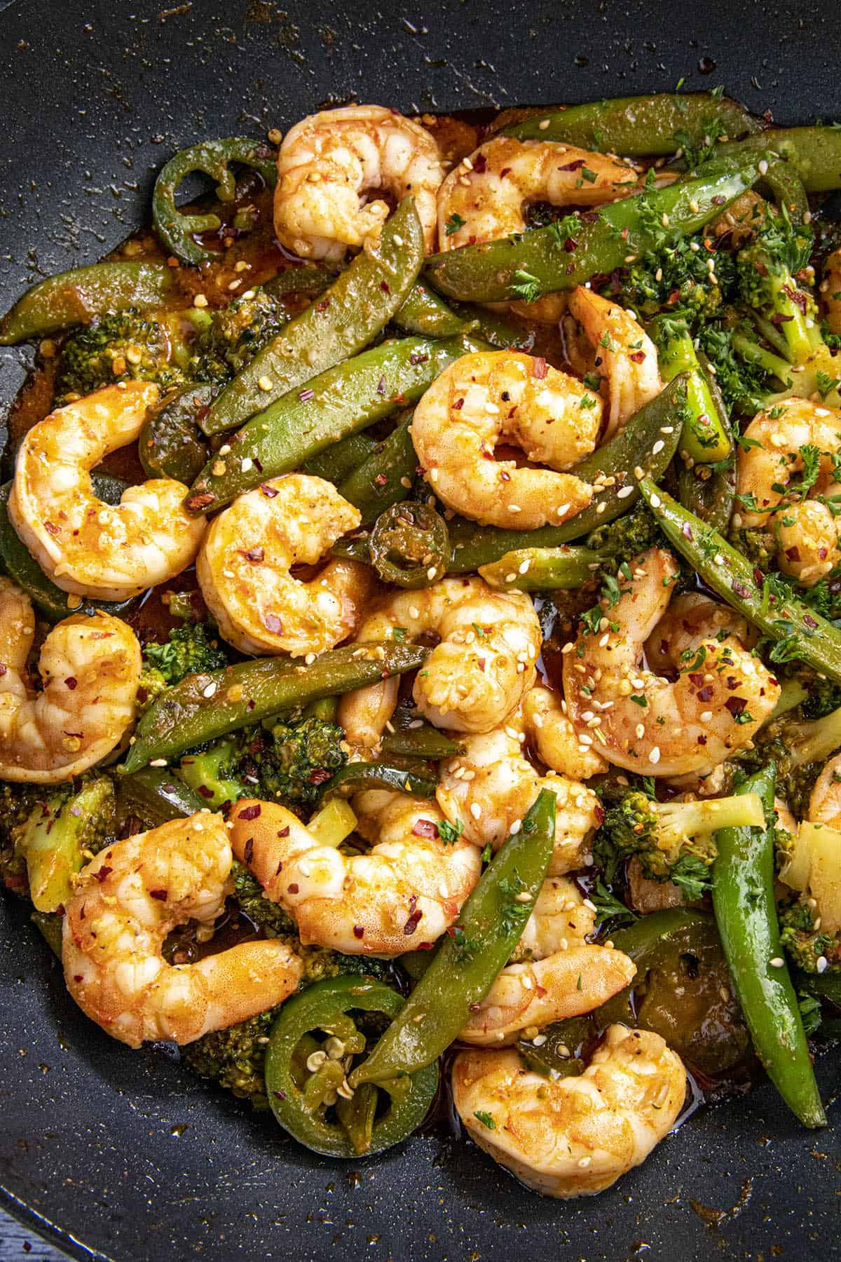 Spicy Shrimp Stir Fry Recipe in a wok with lots of shrimp and vegetables