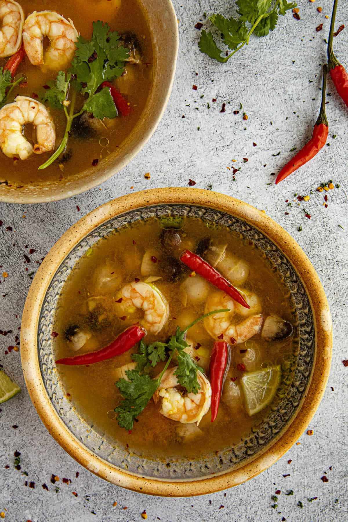 Tom Yum Soup in a bowl with lots of peppers