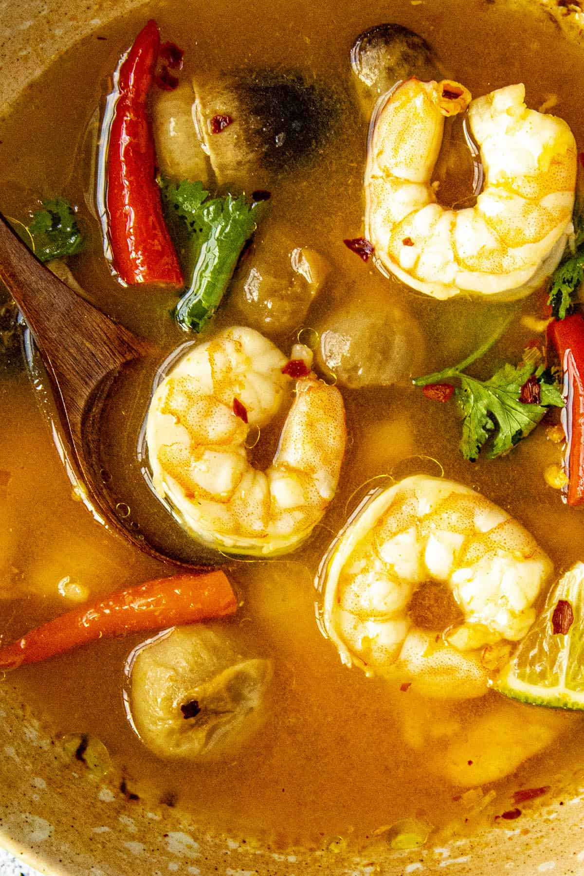 Lots of shrimp in a bowl of Tom Yum Soup