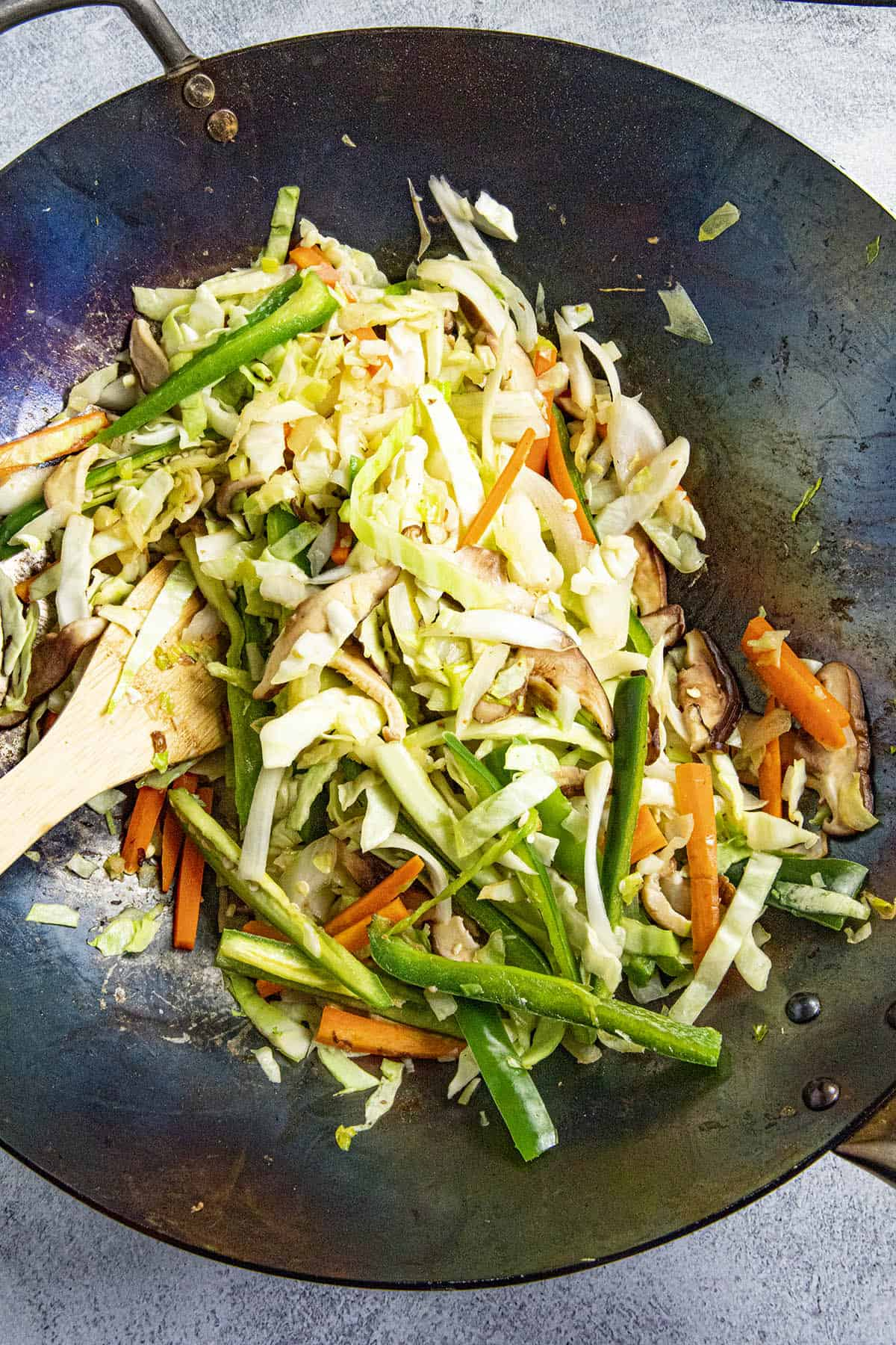 Stir frying the vegetables in the hot wok