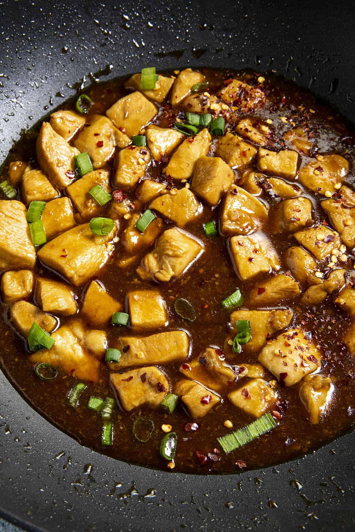 Spicy Bourbon Chicken in a wok