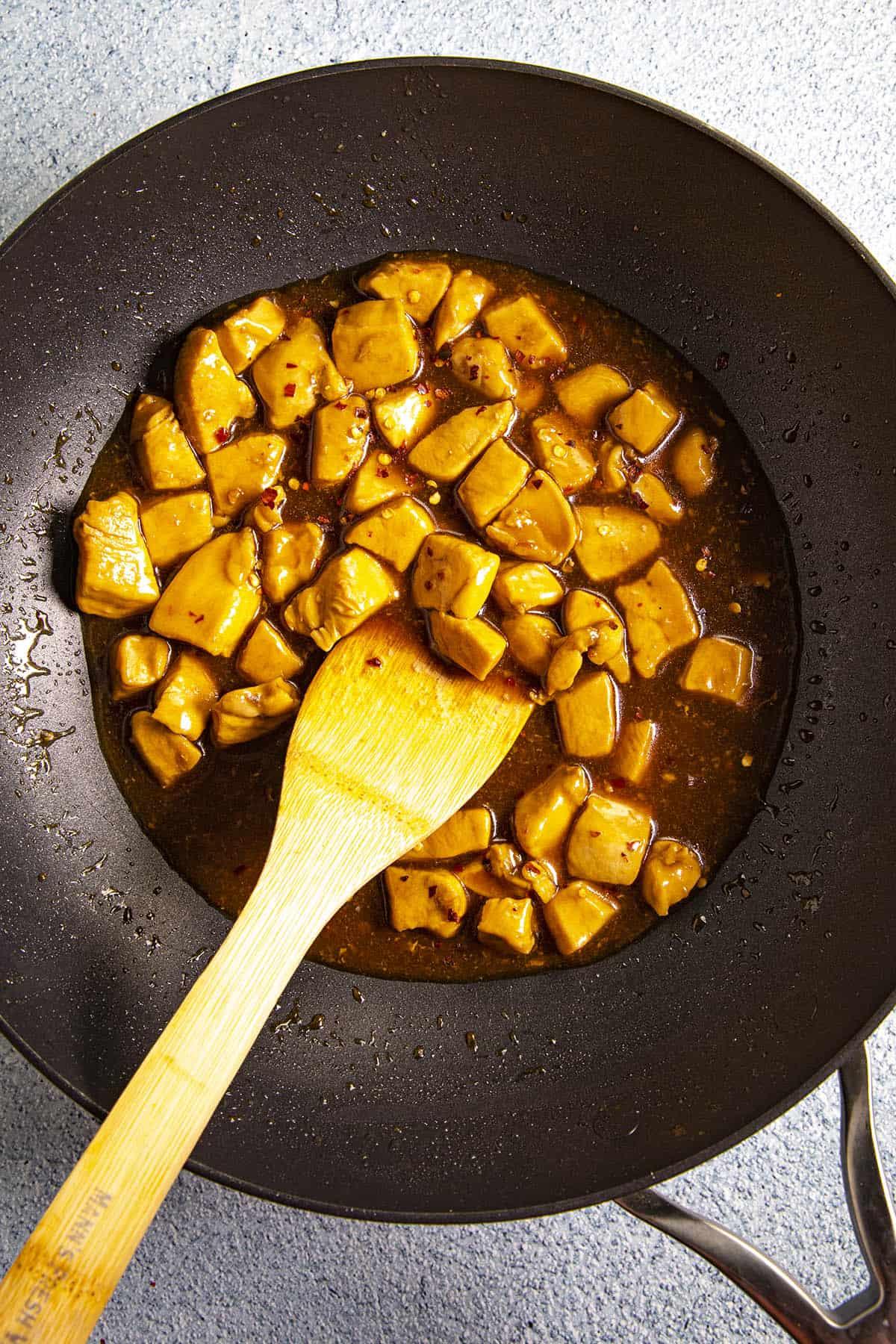 Thickening the Bourbon Chicken sauce in the wok