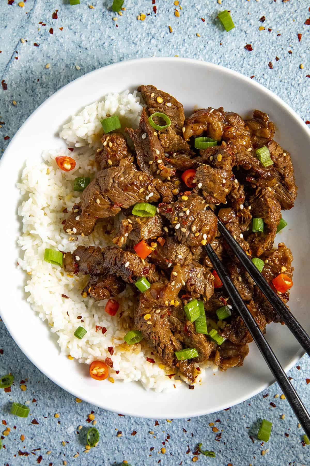 Spicy Korean Bulgogi in a bowl with chopsticks