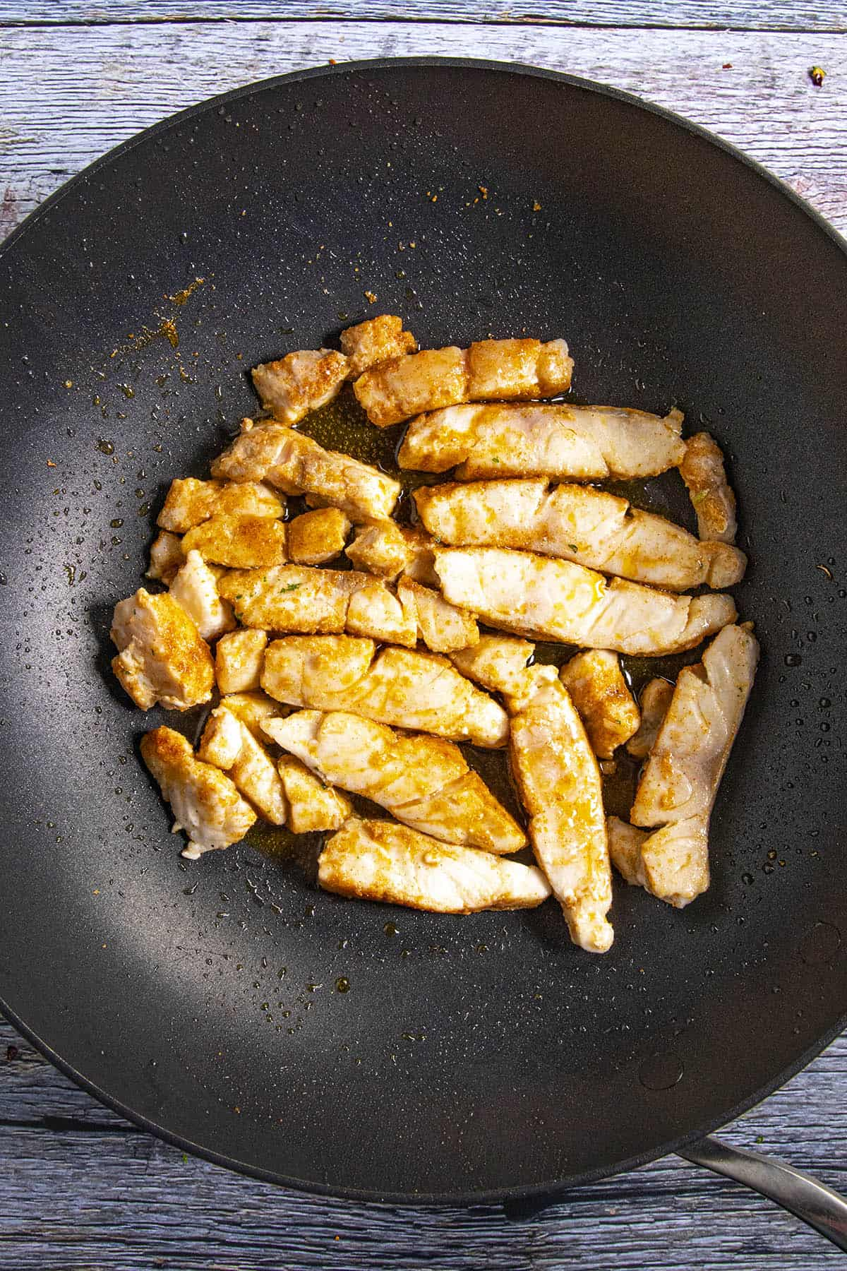 Cooking the fish in a pan to make fish tacos