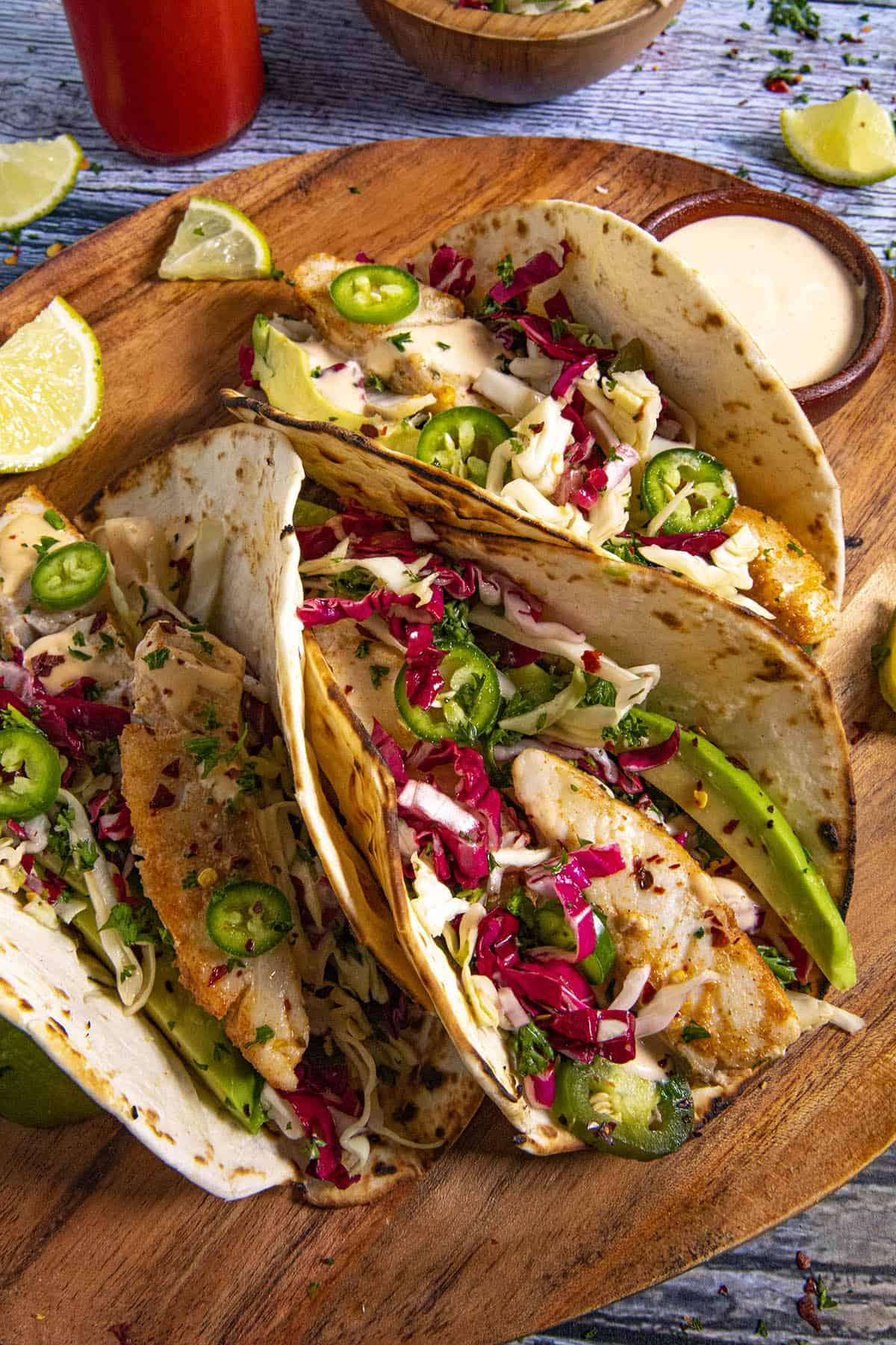 3 Fish tacos with crunchy slaw, avocado and creamy fish taco sauce