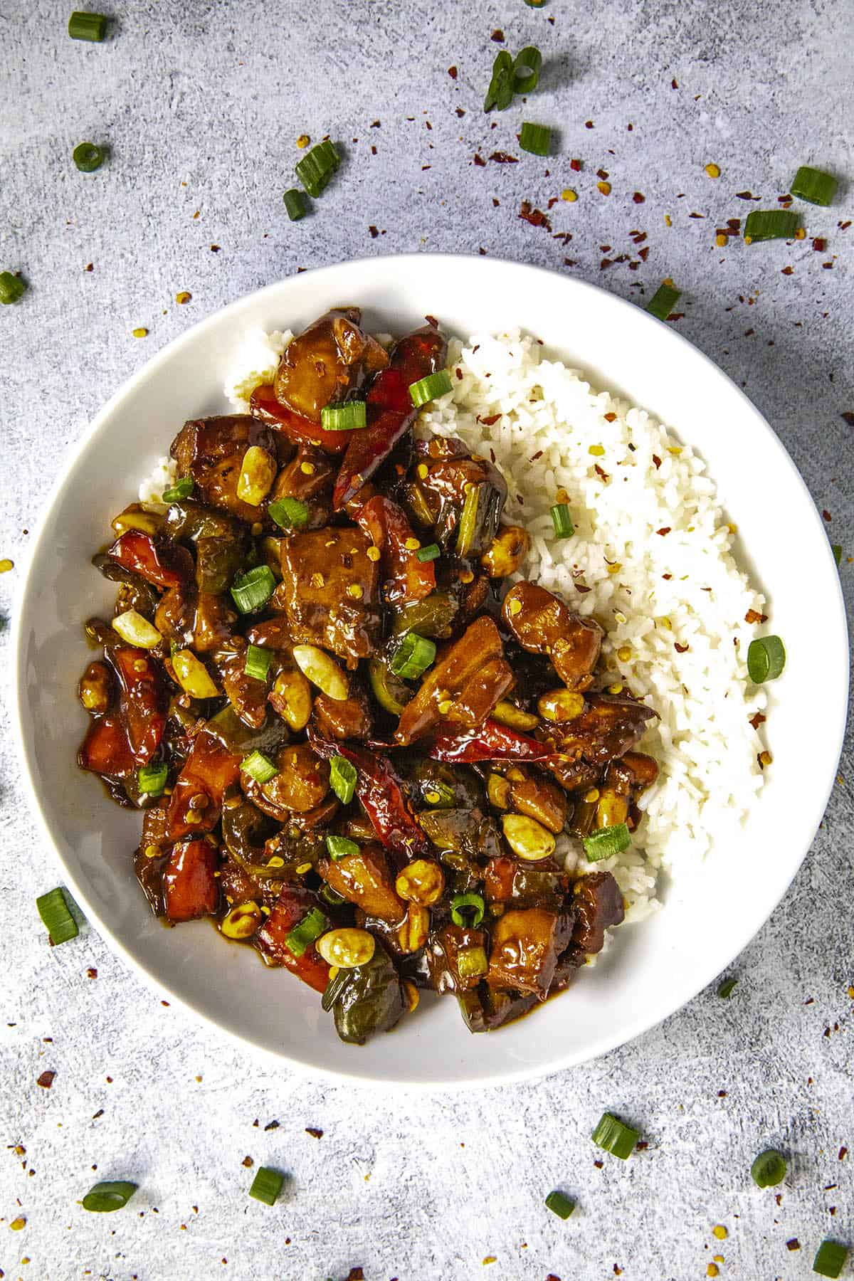 Kung Pao Chicken in a bowl with rice and peanuts