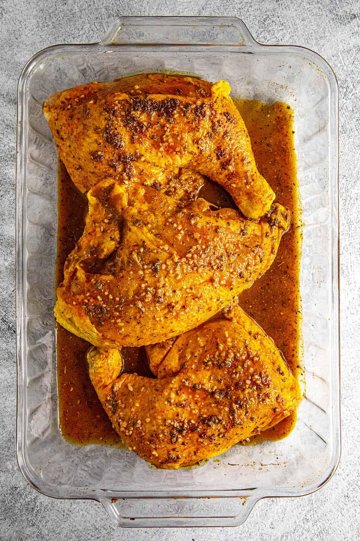 Pollo Asado (Mexican roast chicken) marinating in a dish
