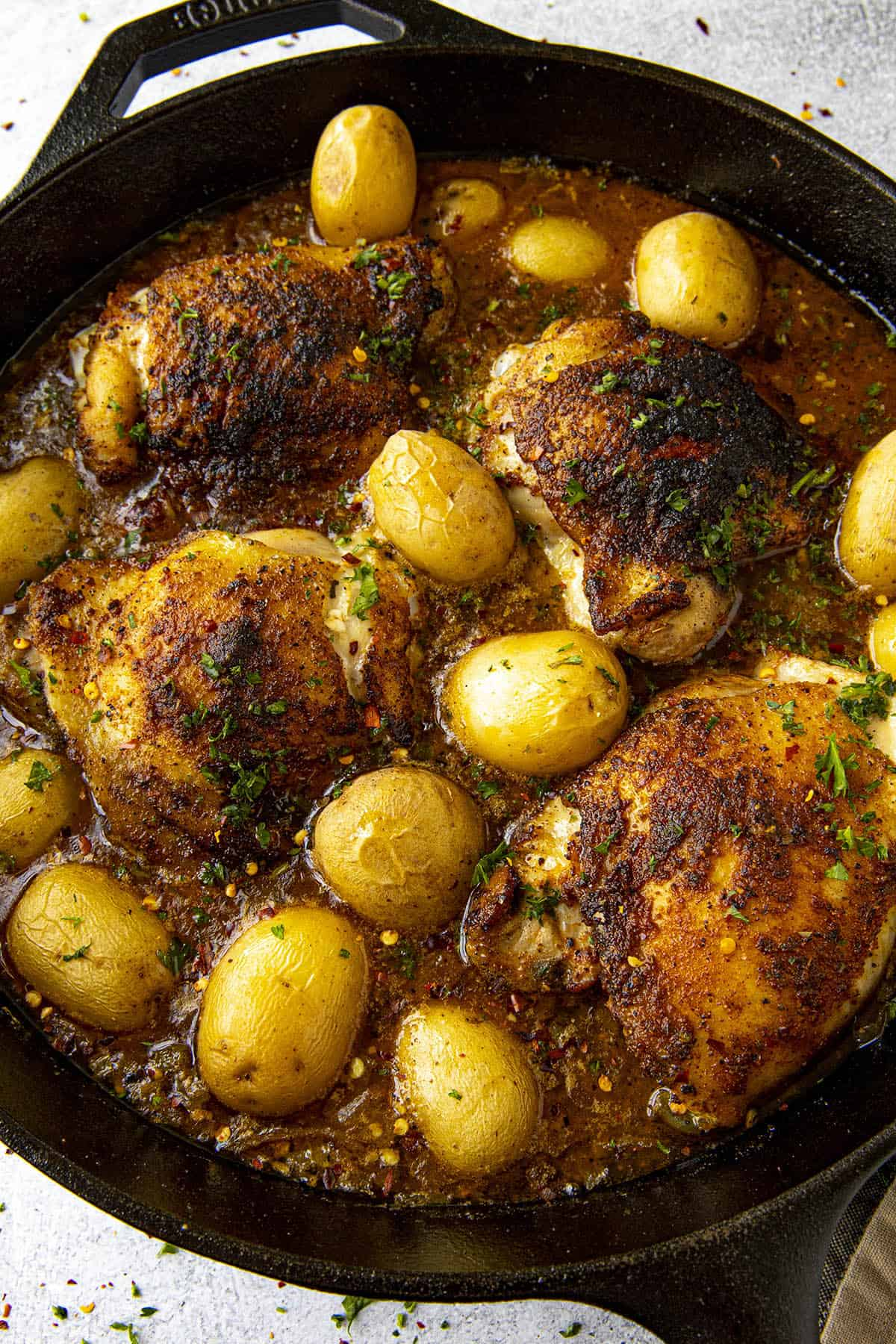 Cajun Baked Chicken Thighs in a hot pan