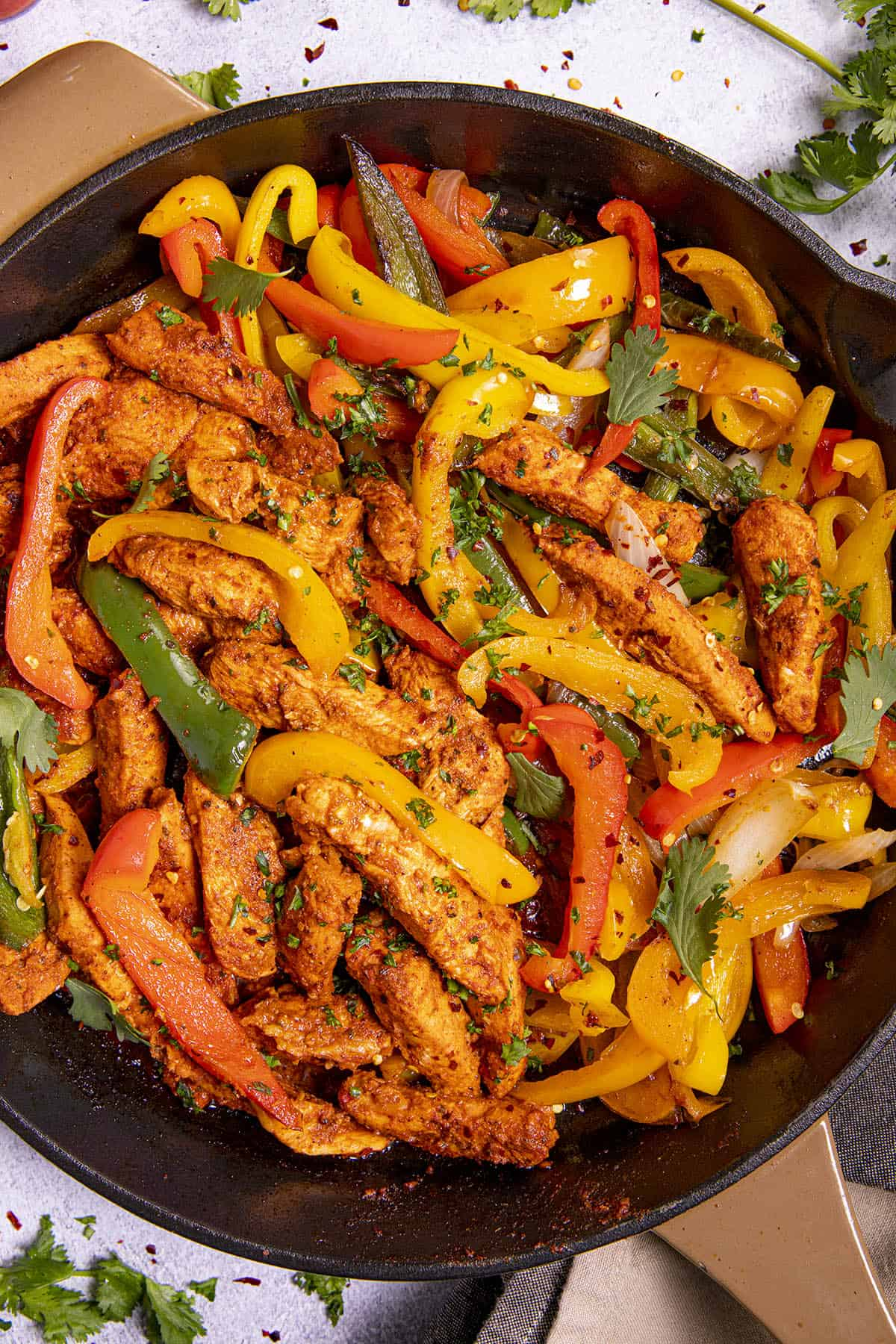 Chicken Fajitas in a pan with lots of colorful bell peppers