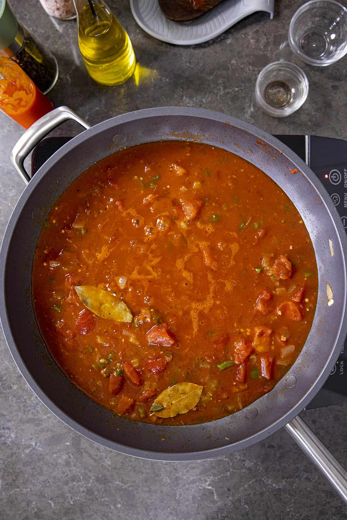 Shrimp Creole simmering in a hot pan