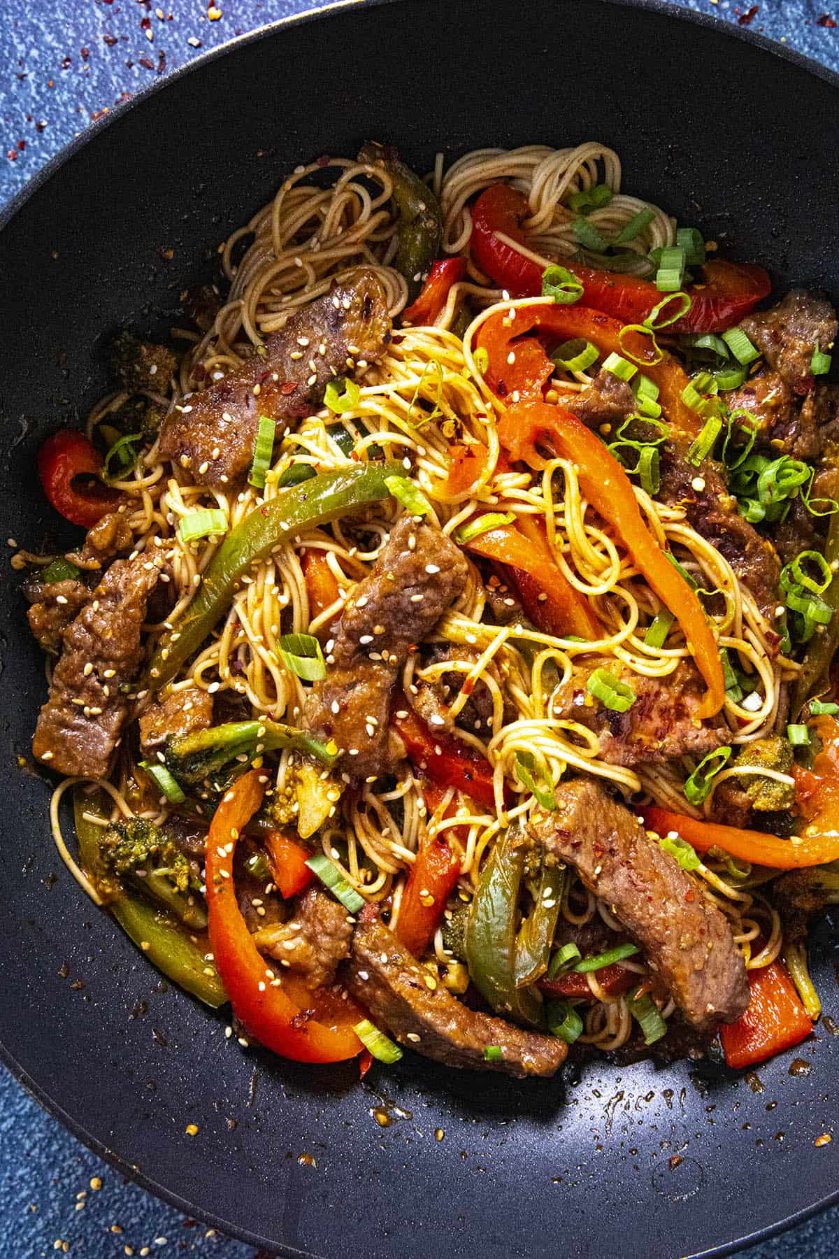 Spicy Beef Stir Fry with noodles in a pan with lots of vegetables