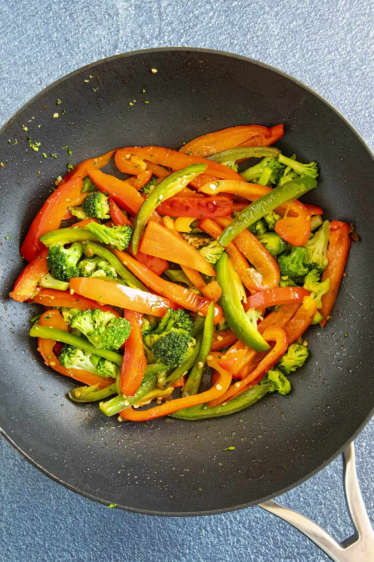 Searing peppers and broccoli into a hot pan