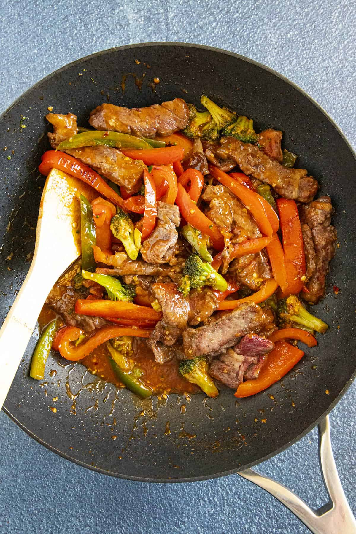 Stirring the peppers and broccoli into the pan with the seared beef