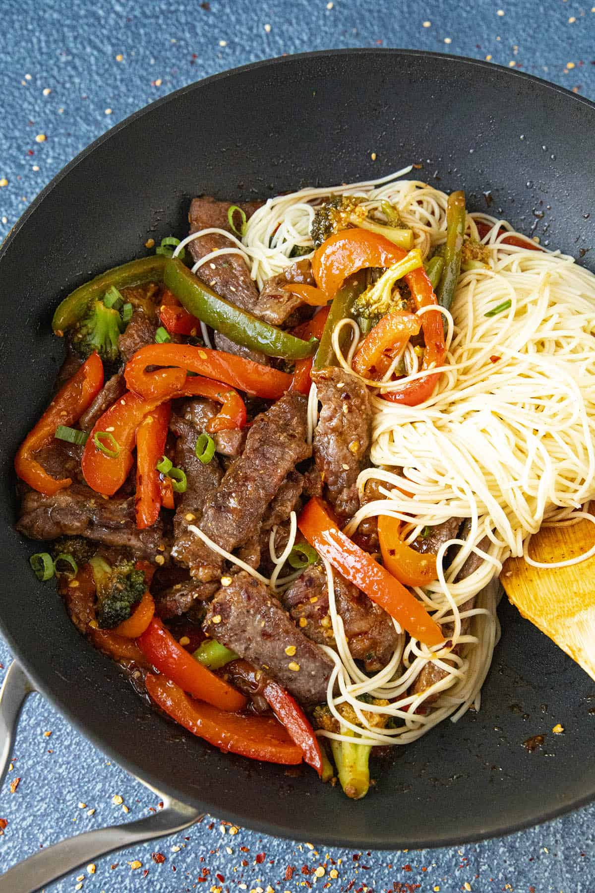 Stirring noodles into the Beef Stir Fry