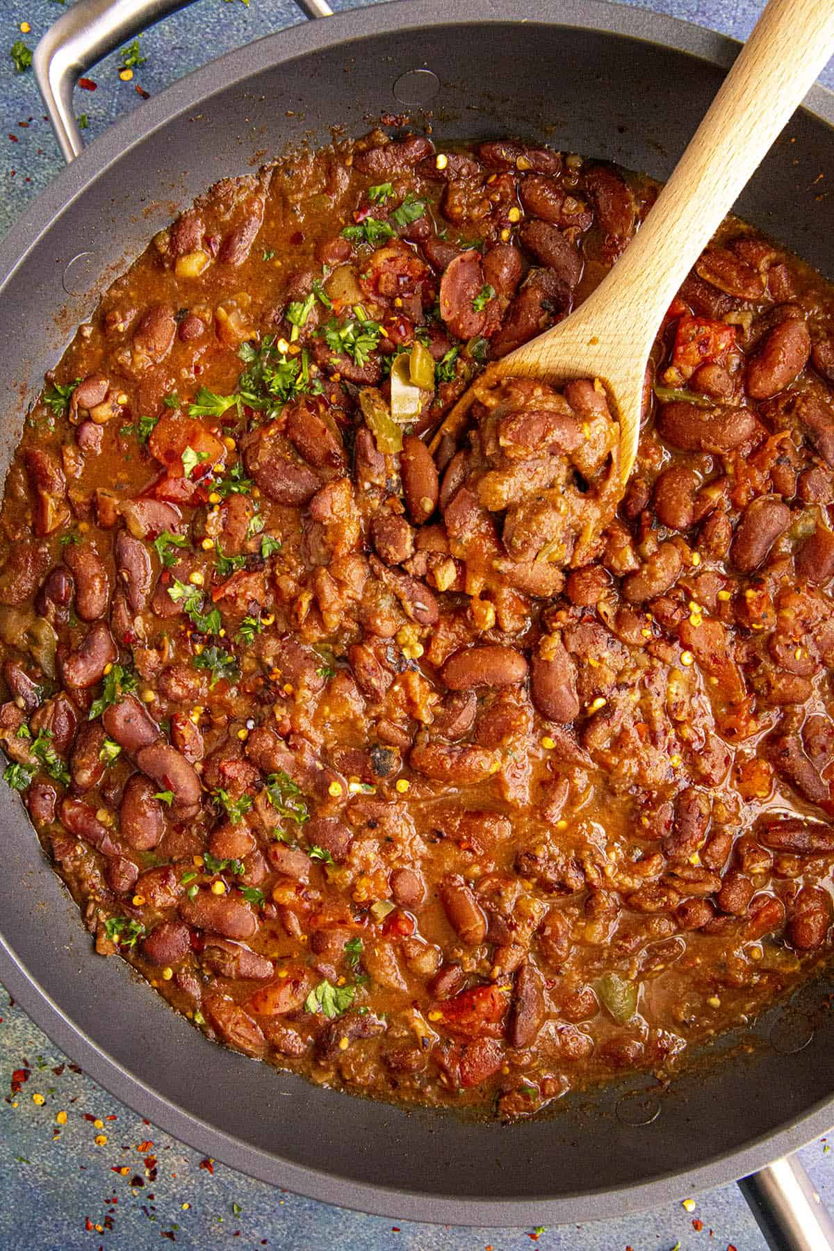 A big scoop of Charro Beans in a pan