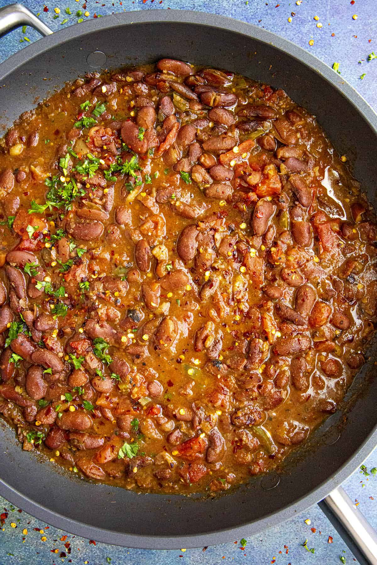 Charro Beans in a pan with garnish