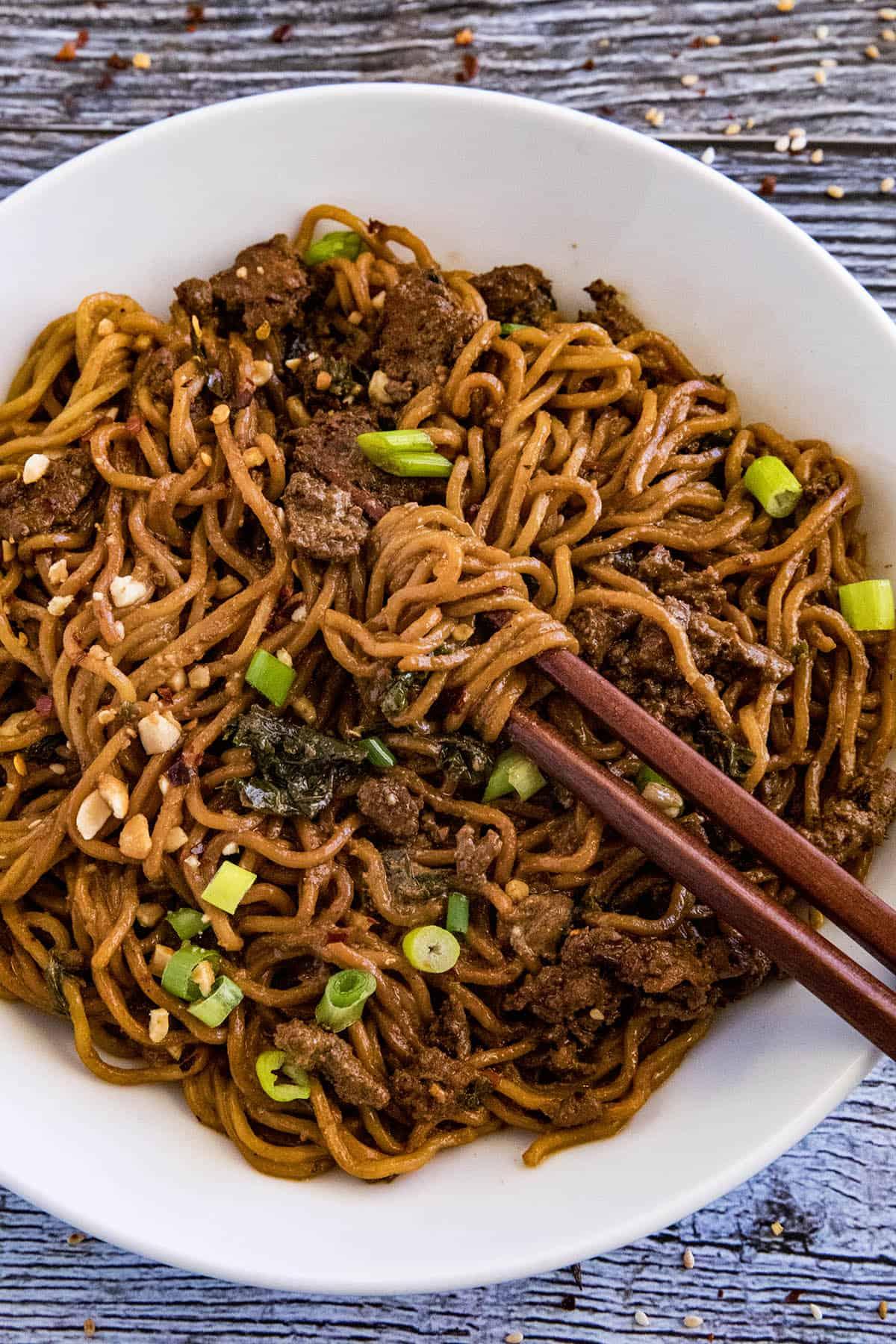 Dan Dan Noodles in a bowl with chopsticks