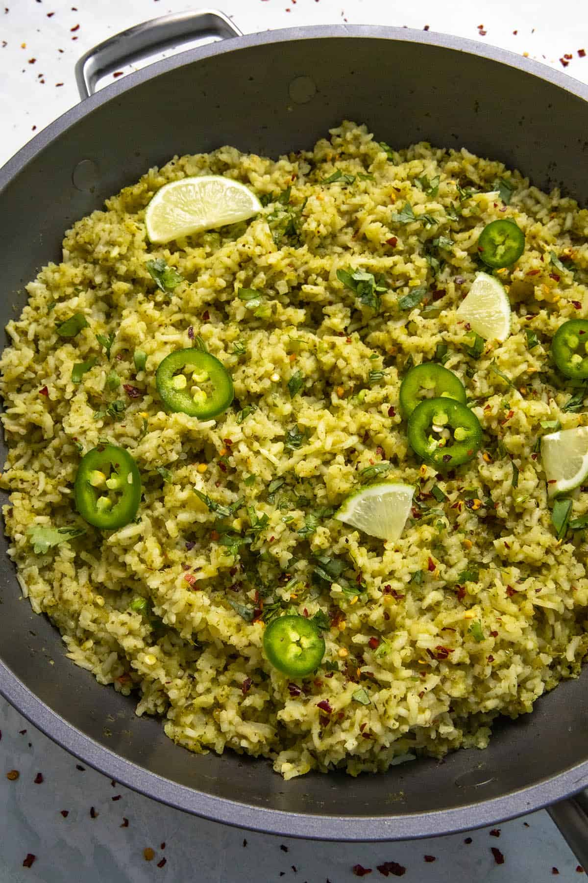 Arroz Verde in a hot pan with garnish