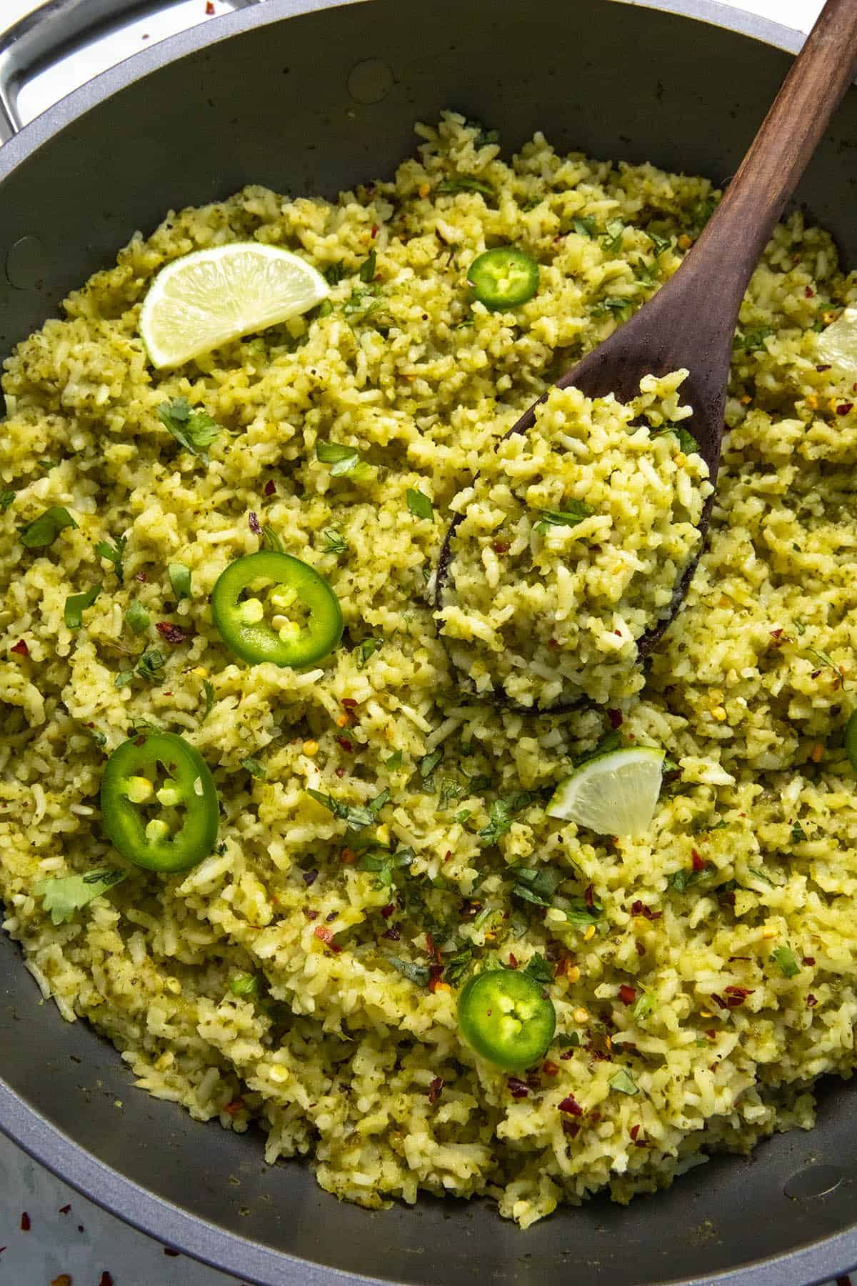 Serving Arroz Verde from the hot pan