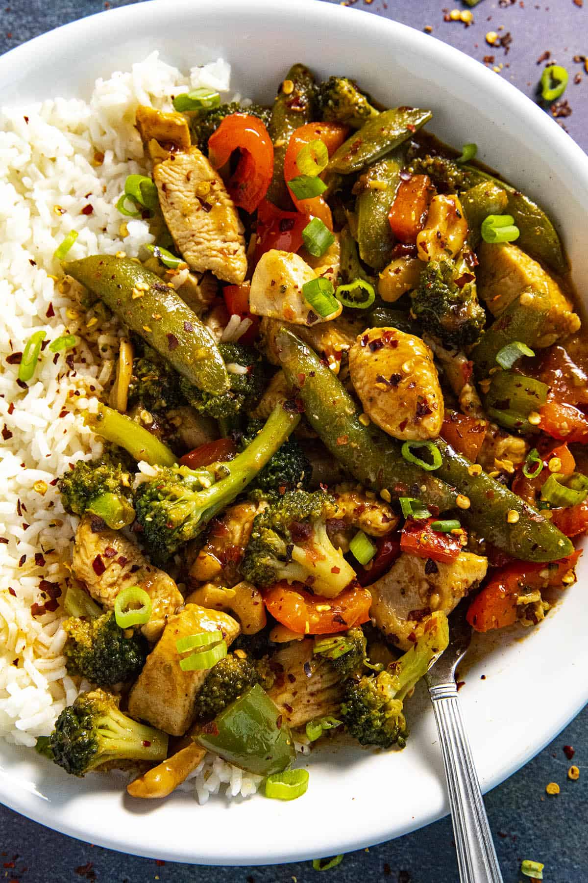 Chicken Stir Fry in a bowl with white rice, ready to serve