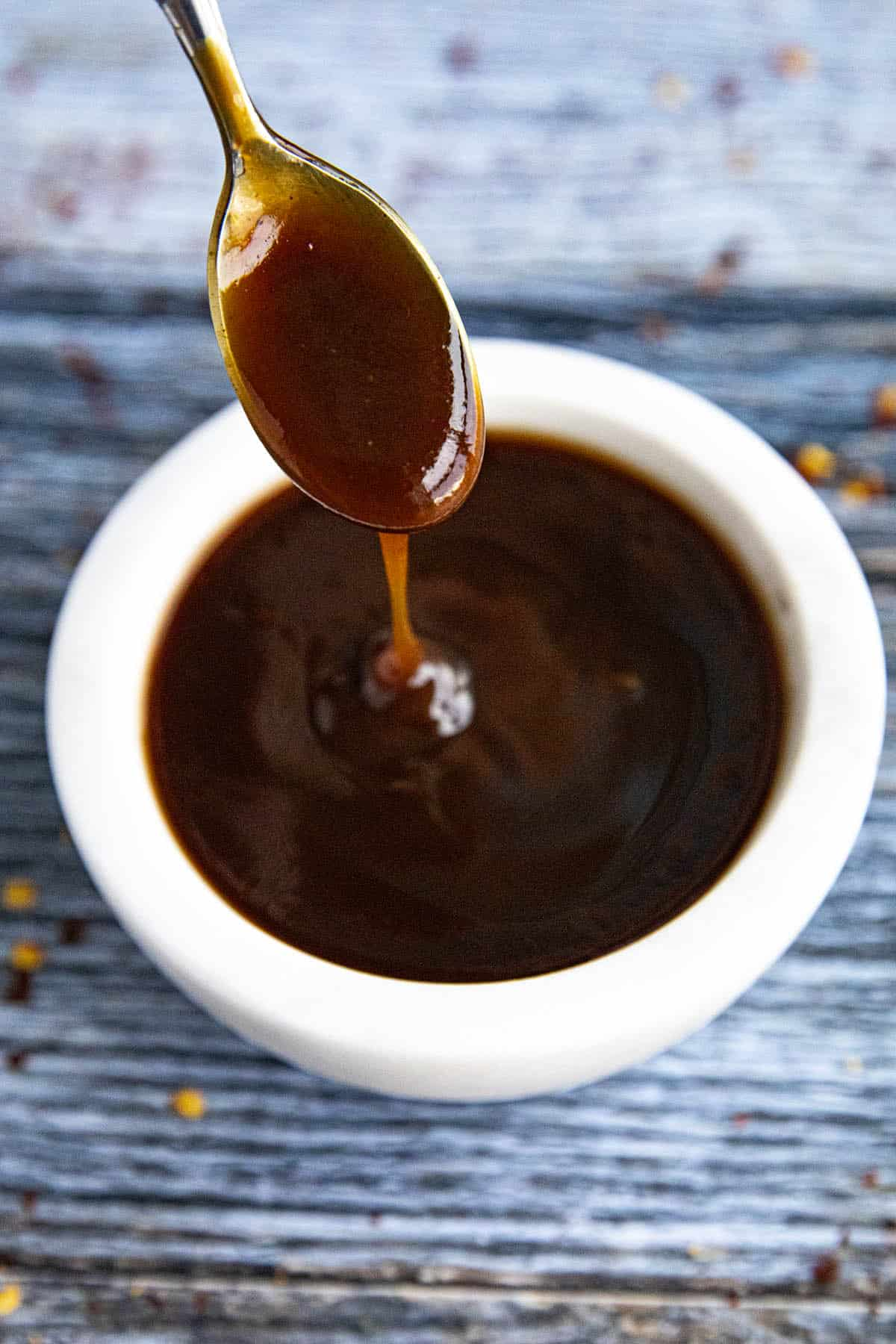 Easy Tonkatsu Sauce dripping from a spoon