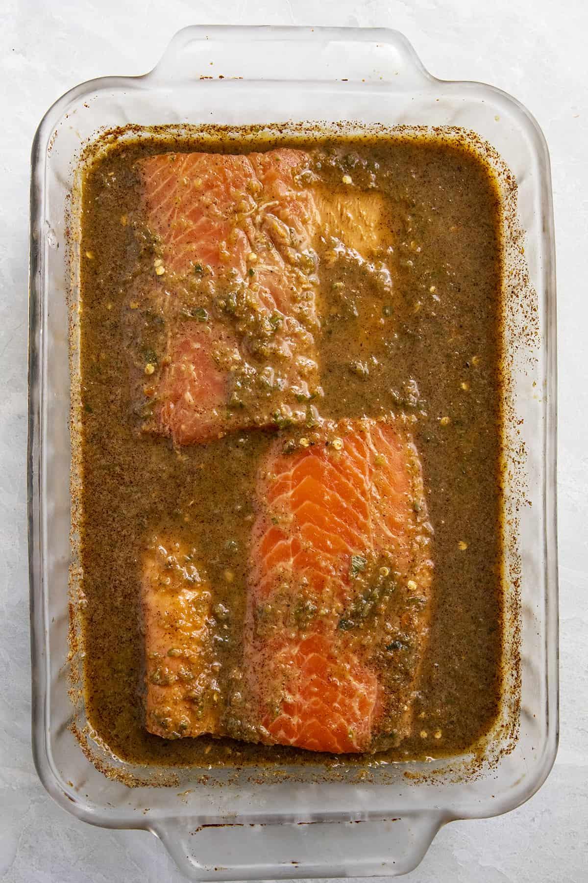 Jerk Salmon marinating in a spicy Jamaican jerk marinade