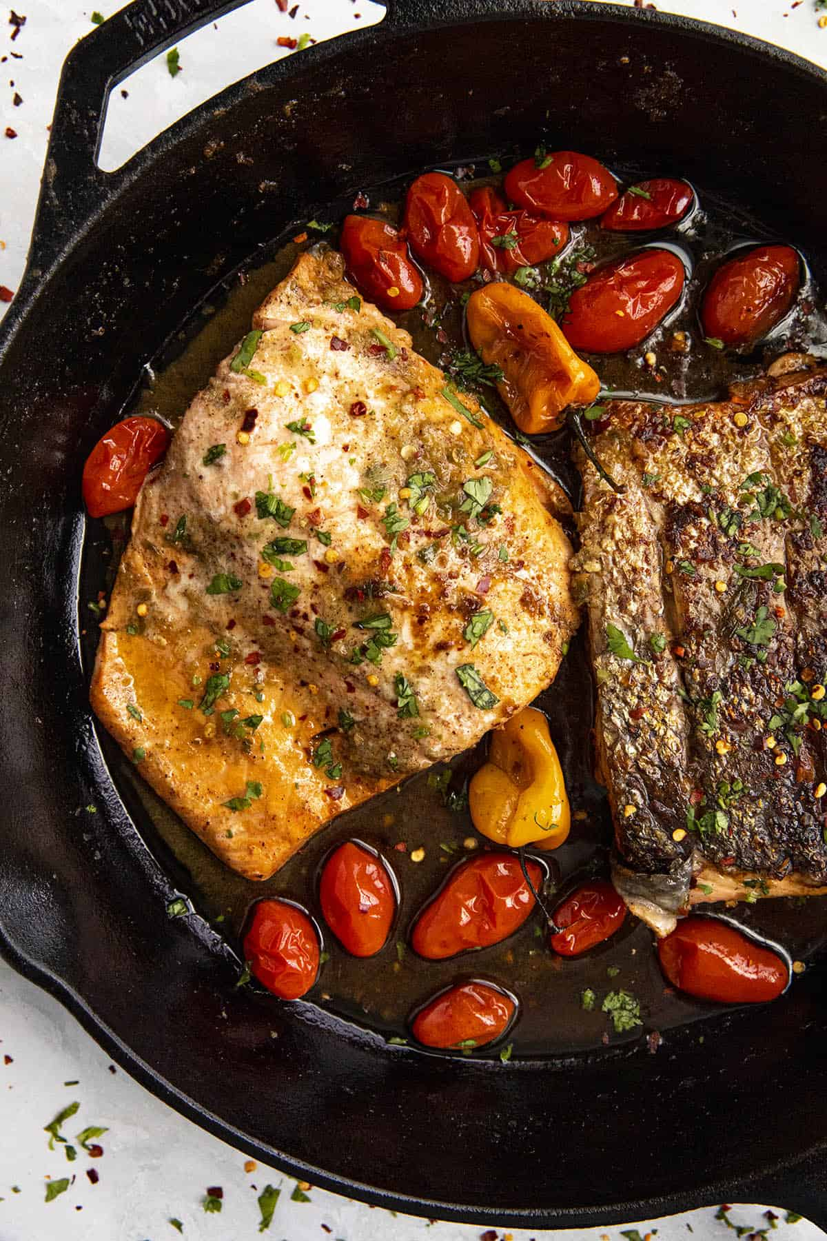 Two pieces of Jerk Salmon in a hot pan