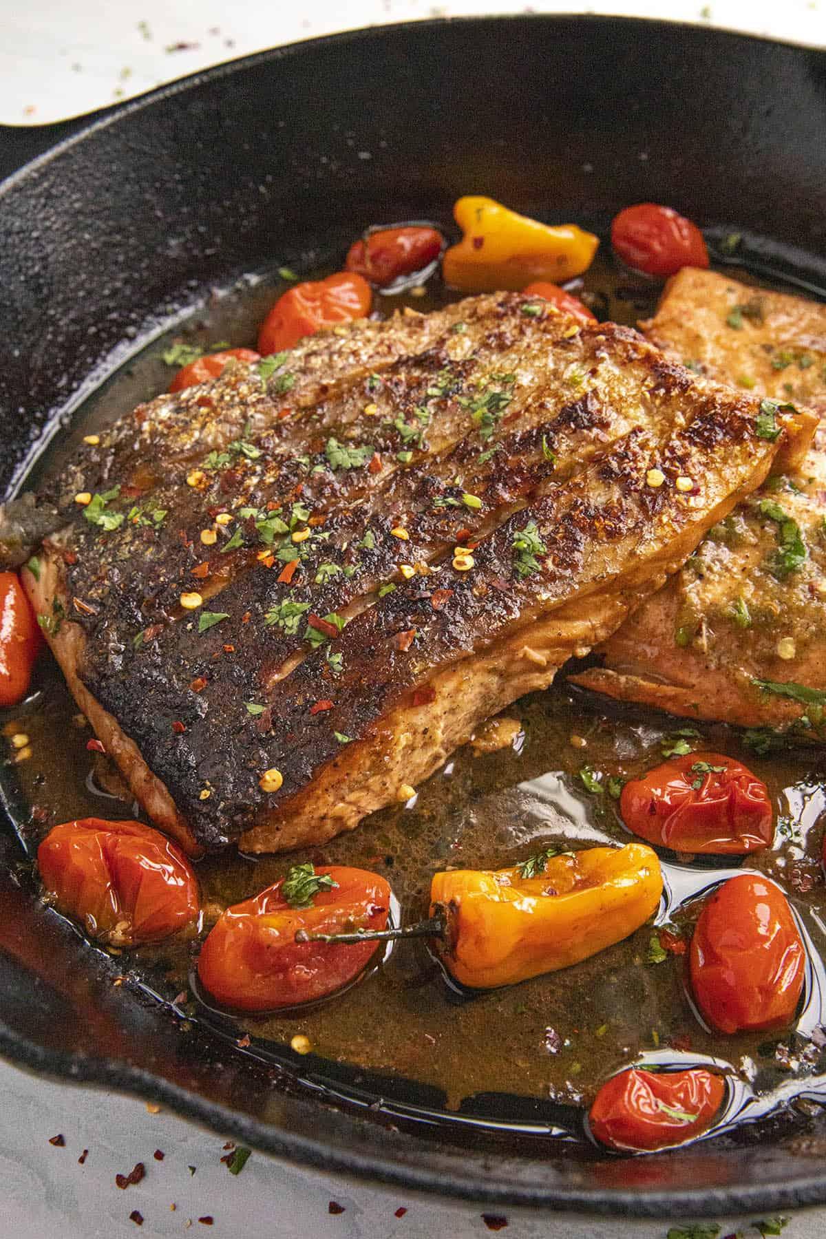 Crispy Skin side up Jerk Salmon in a pan