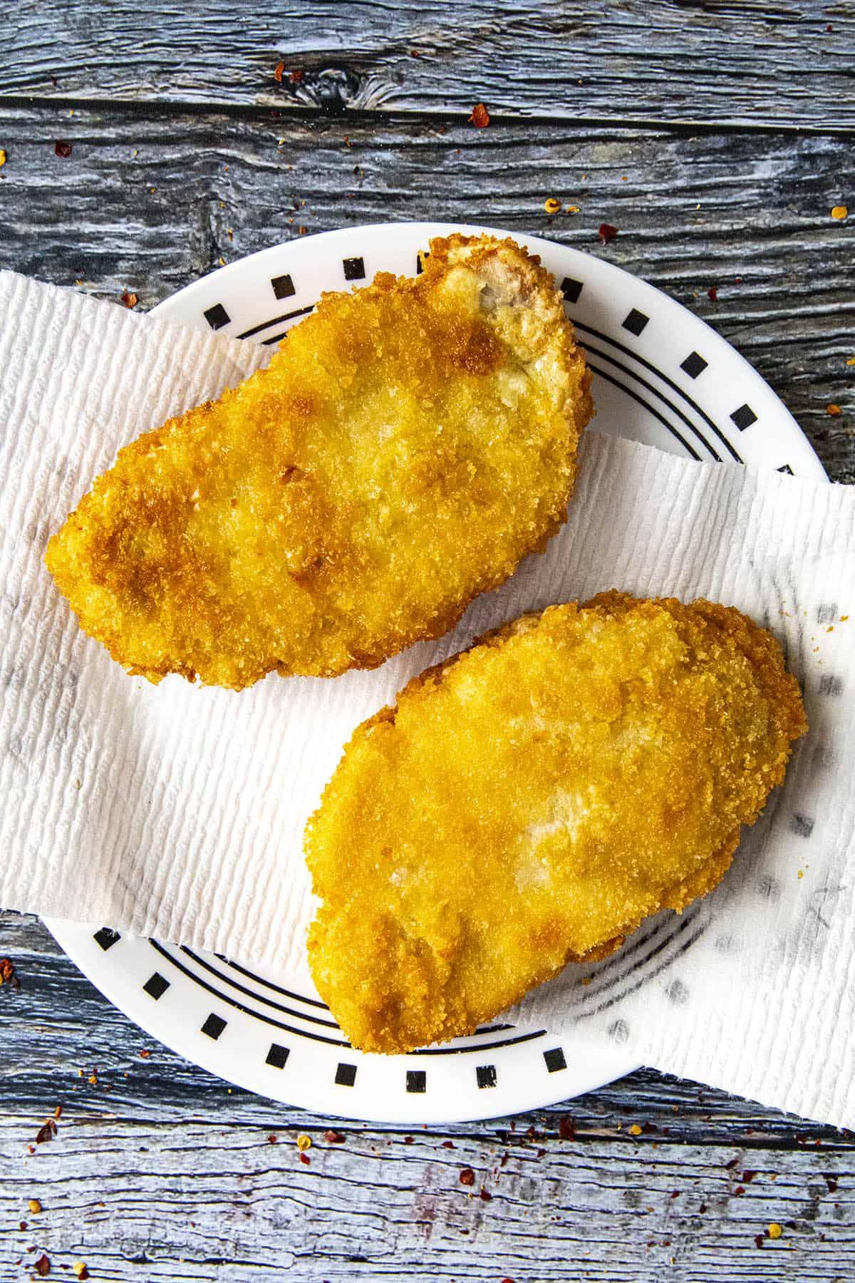 Fried panko breaded pork cutlets on a plate