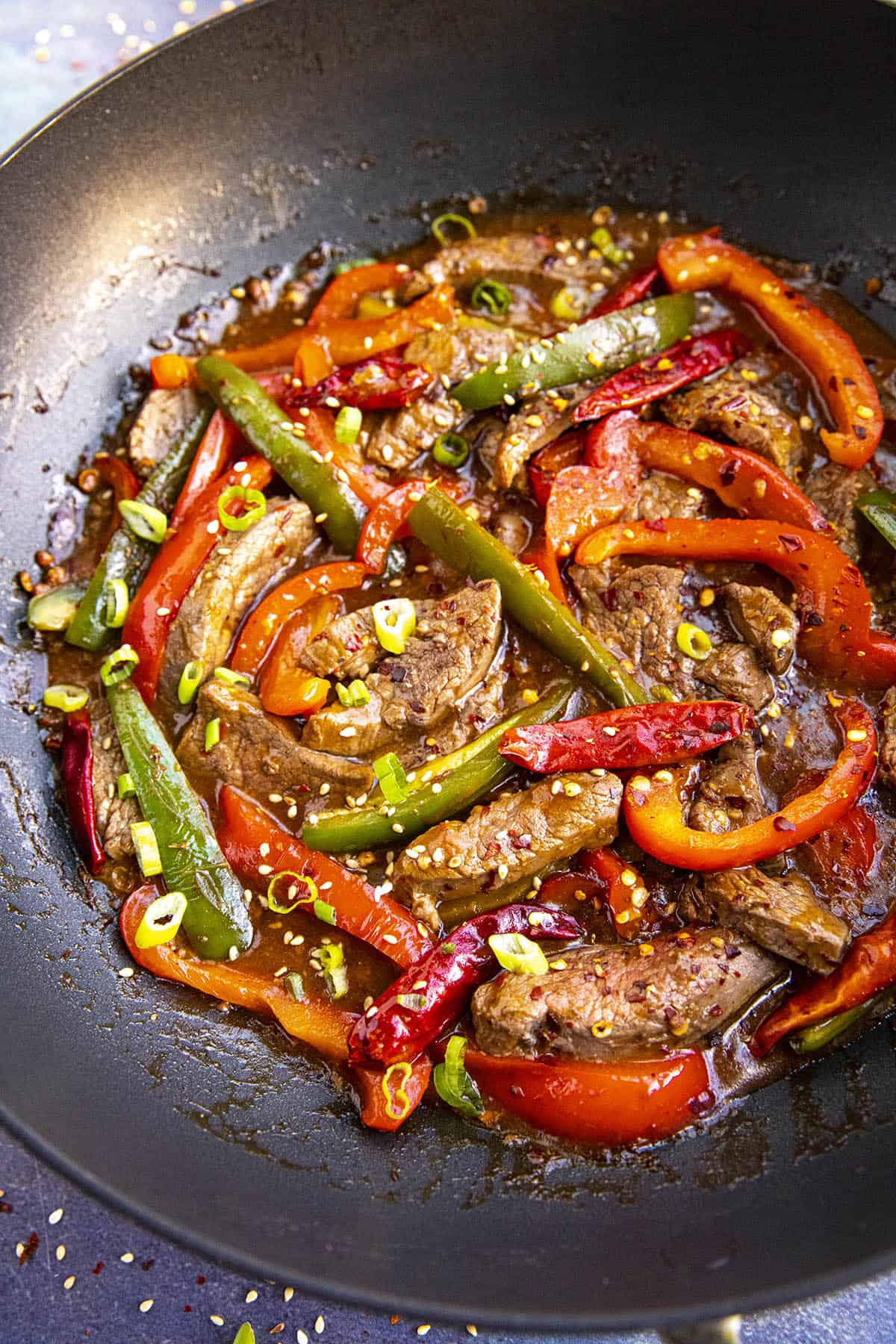 Szechuan Beef in a pan with lots of peppers