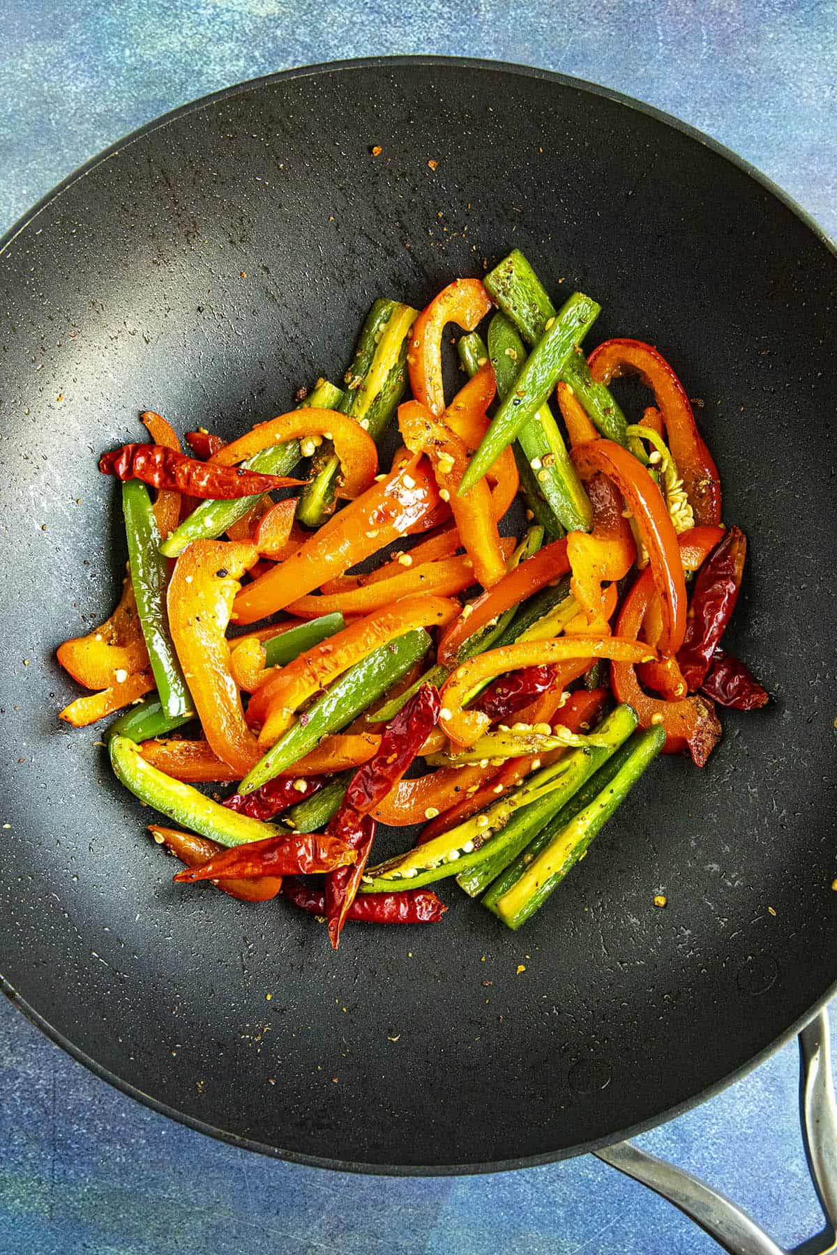 Cooking the peppers in a hot pan