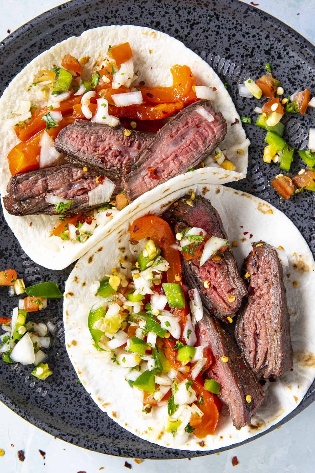 Two charcoal grilled steak tacos