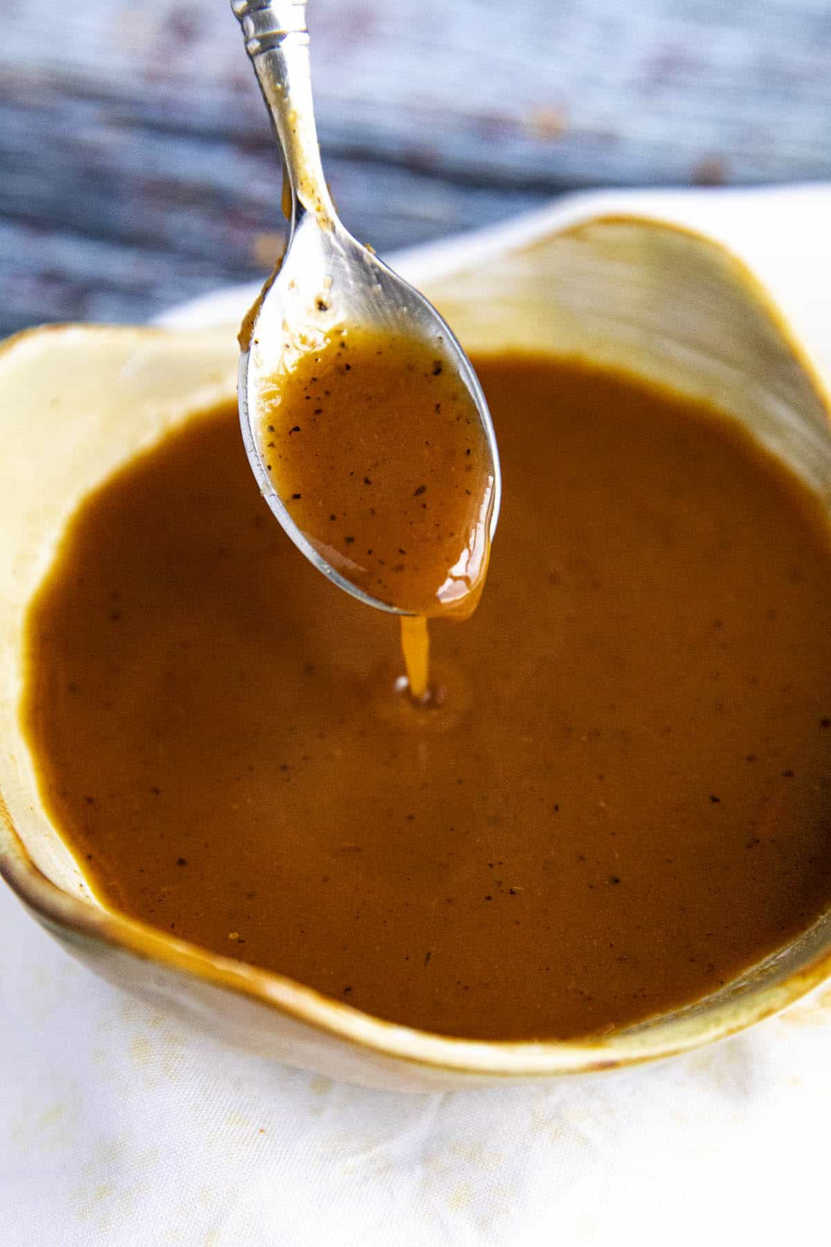 Tonkatsu Sauce dripping from a spoon