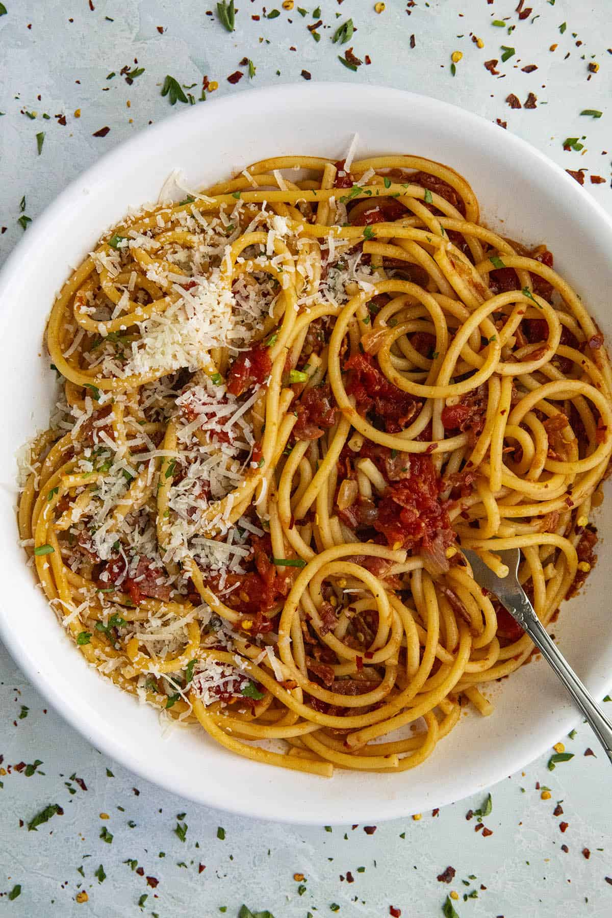 Bucatini all Amatriciana in a bowl with parmesan cheese