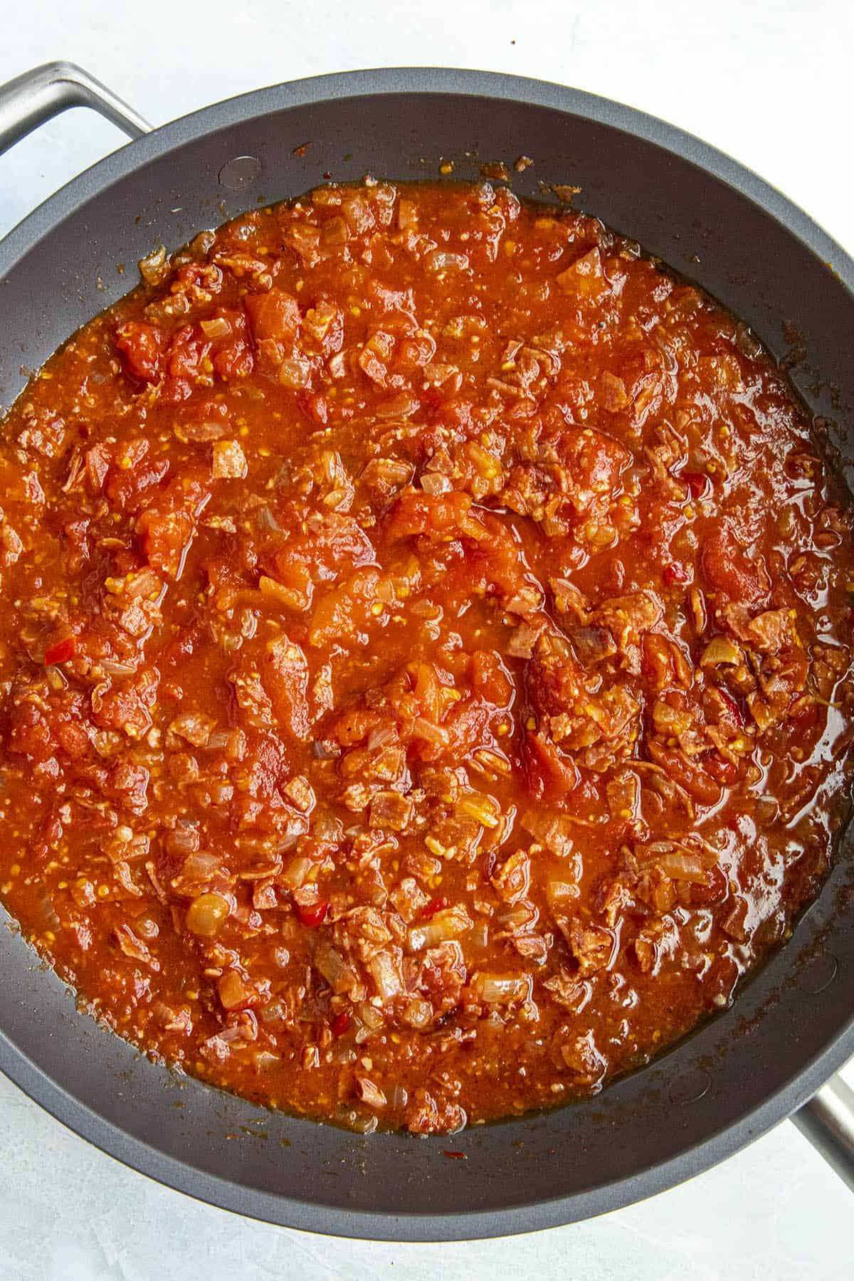 Simmering Amatriciana sauce in a pan